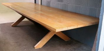 A contemporary light oak refectory table, the six plank top,