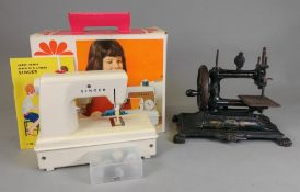 A child's battery operated Singer sewing machine, circa 1960's,