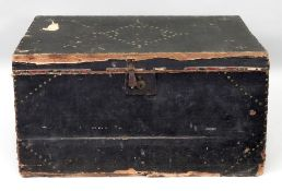 A 19th century brass studded black canvas covered trunk with carrying handles,