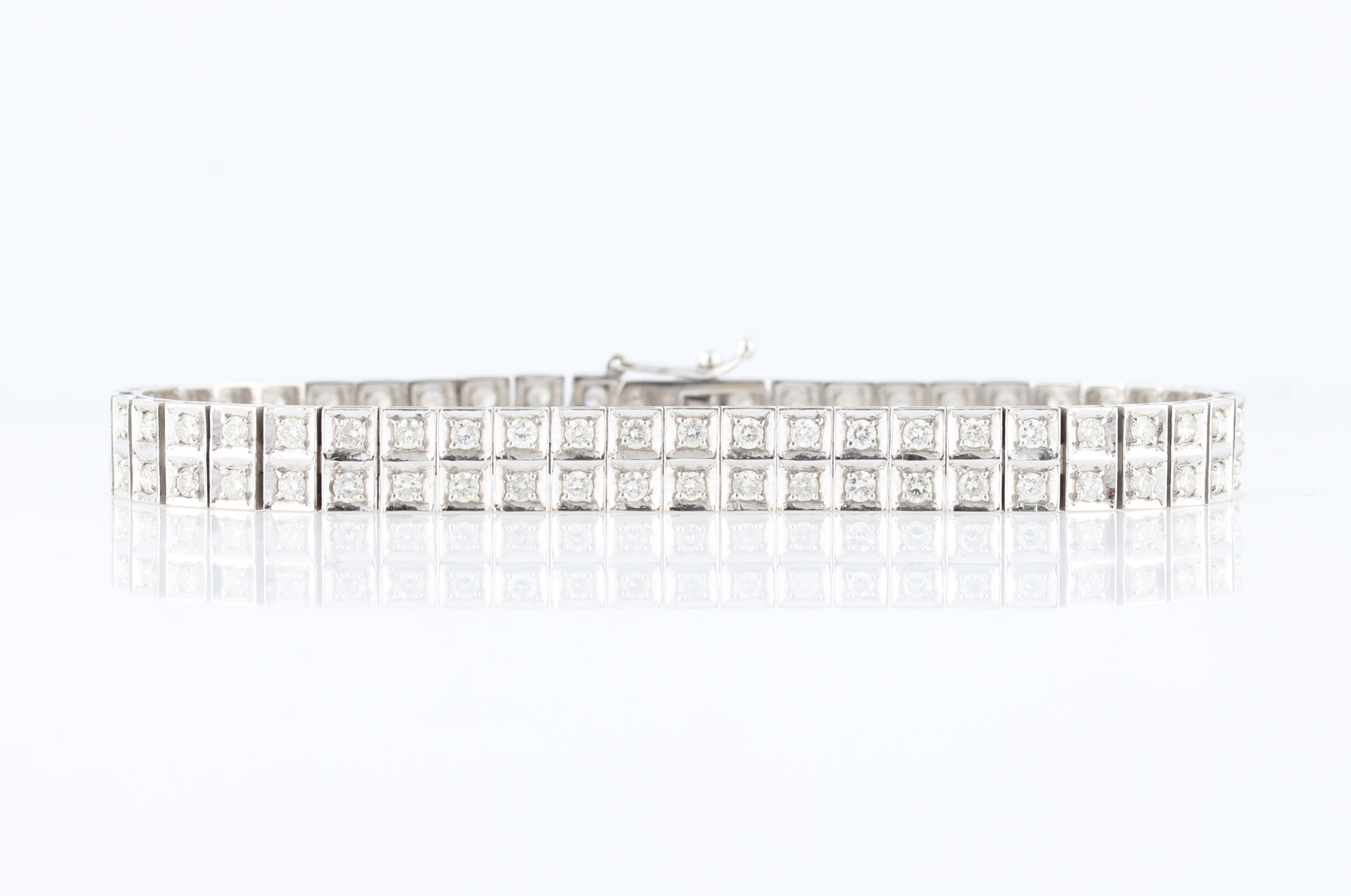 Lot 36 - A two row diamond bracelet, set with ninety-two round brilliant cut diamonds in square articulated