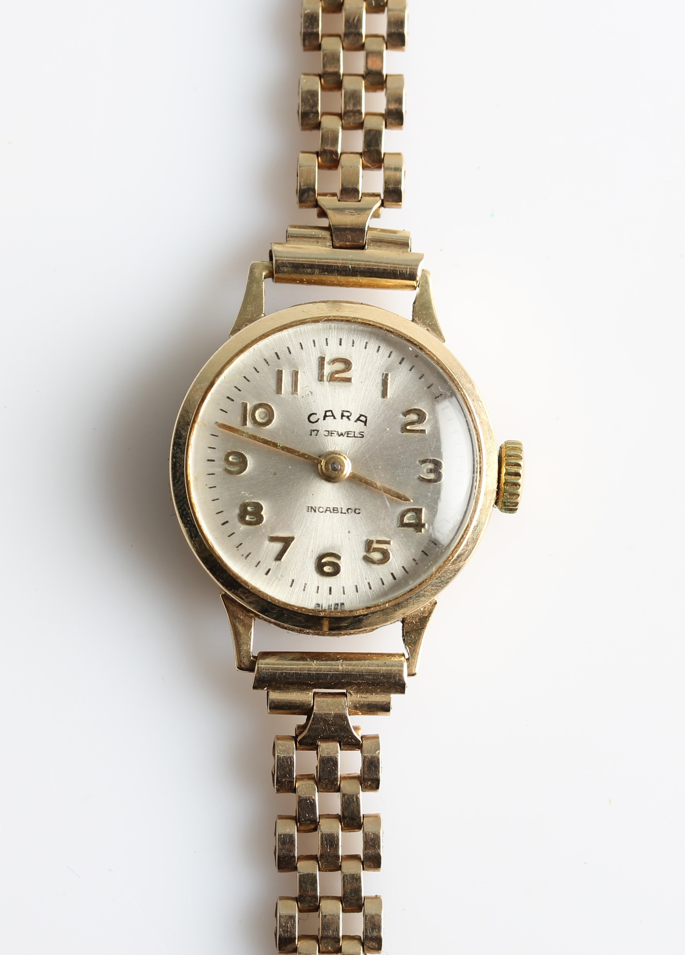 Lot 31 - A ladies Cara wrist watch, the silver-tone dial having hourly Arabic numeral markers with a minute
