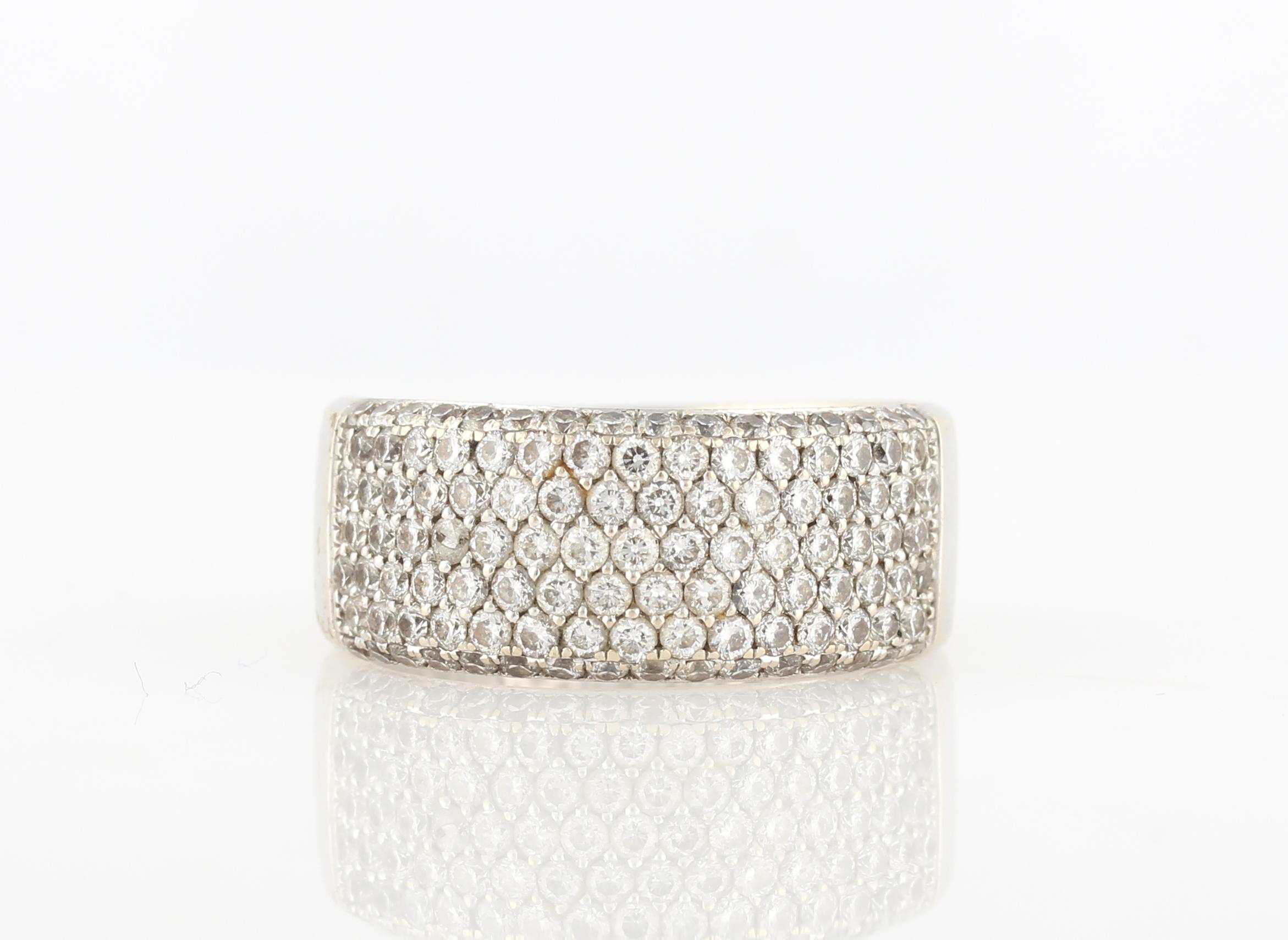 Lot 40 - A diamond half band, pavé set with seven rows of round brilliant cut diamonds, total diamond