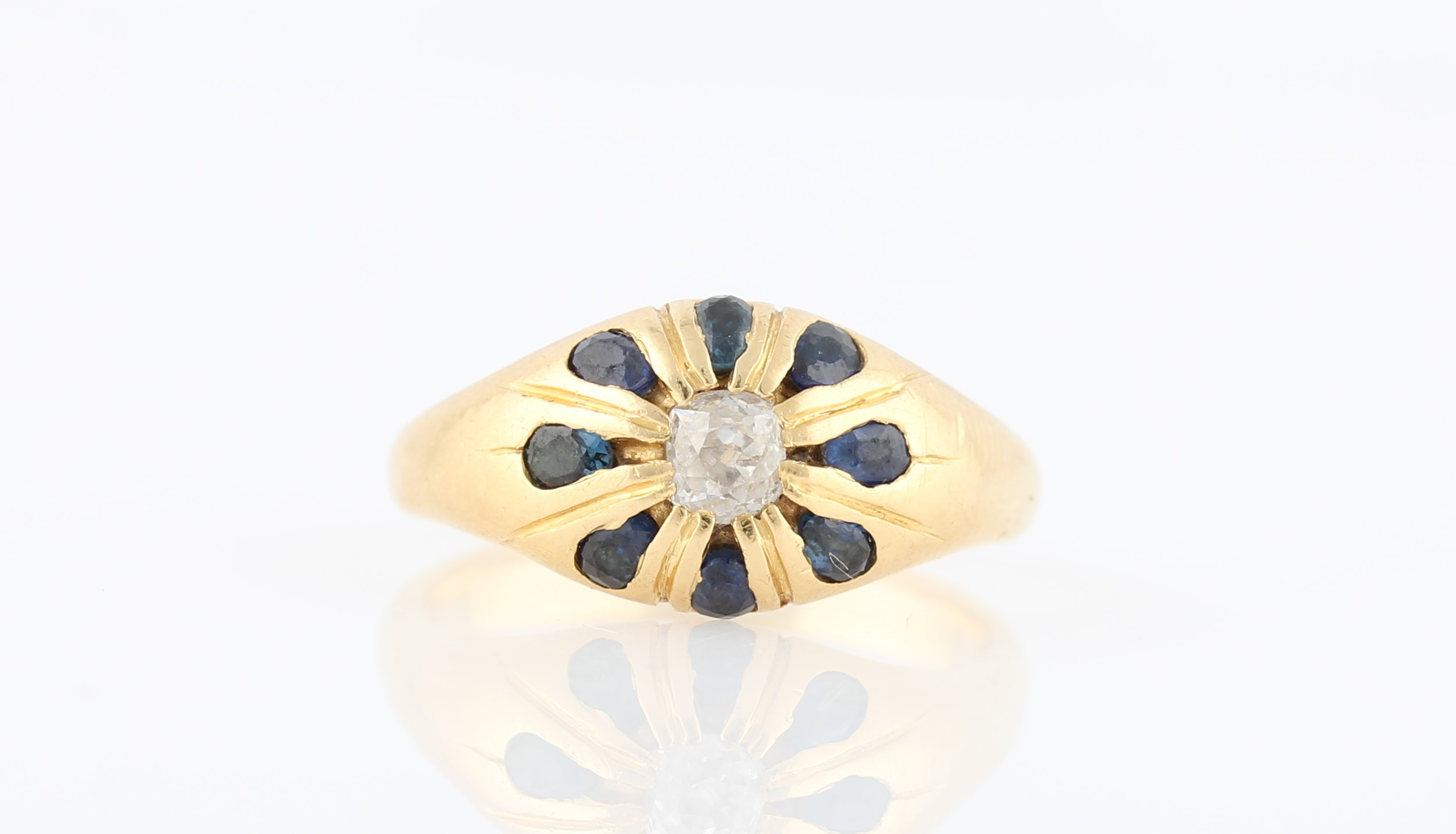 Lot 45 - A hallmarked 18ct yellow gold sapphire and diamond cluster ring, set with a central round cut