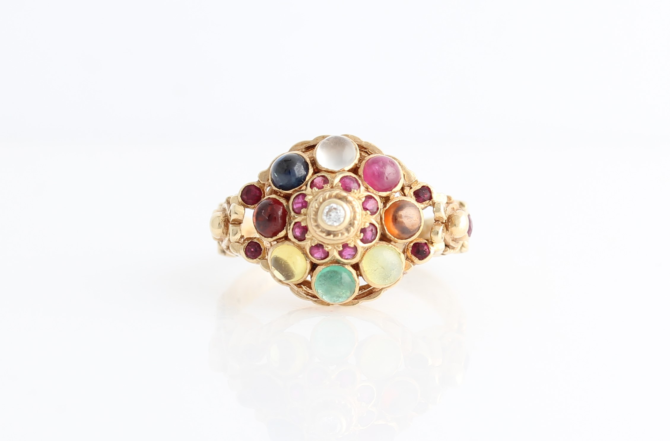 Lot 34 - A multi gemstone cluster ring, the open metalwork tiered design set with various facetted and