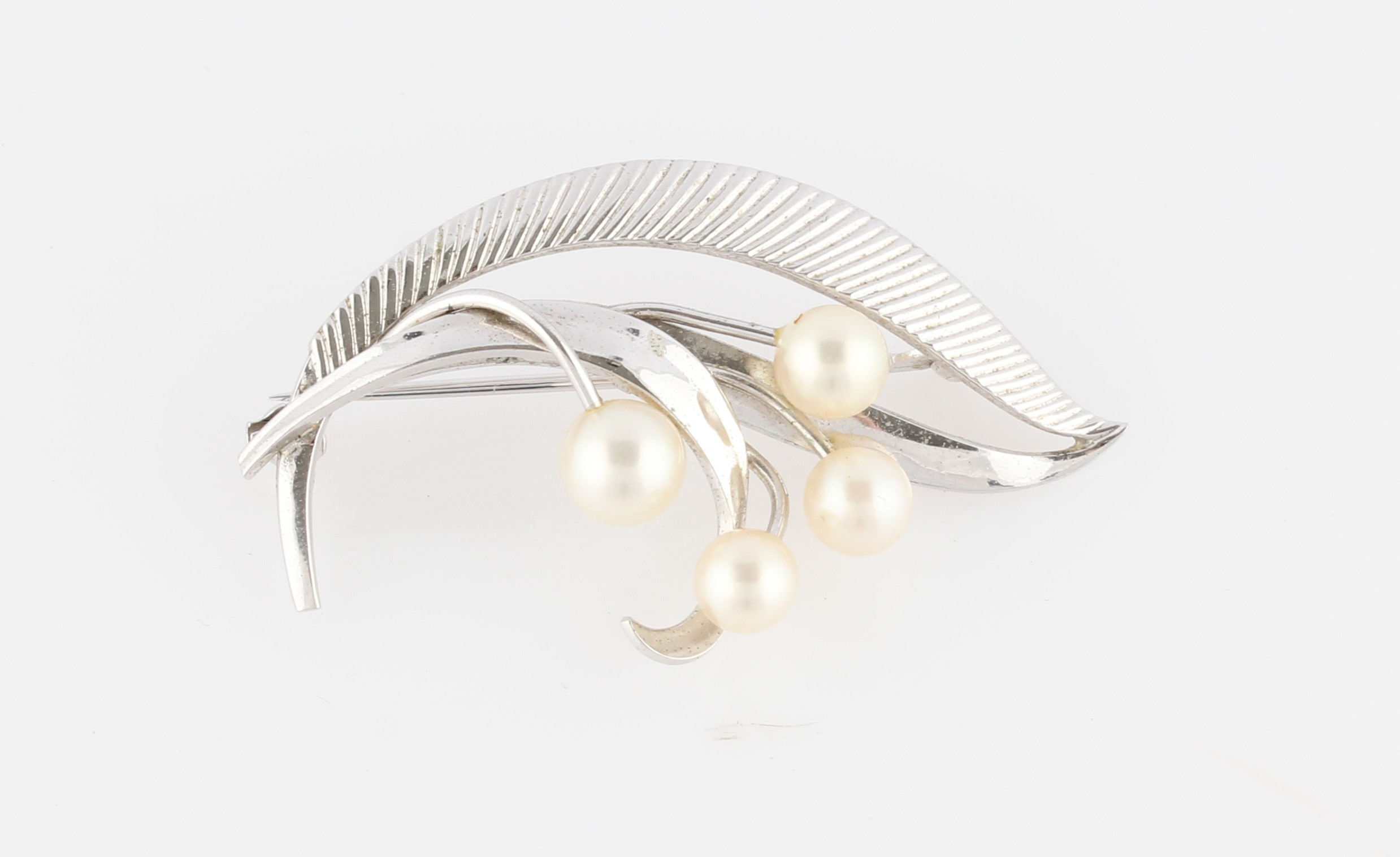 Lot 21 - A Mikimoto pearl brooch, set with four variously sized pearls, smallest measuring approx. 5mm and