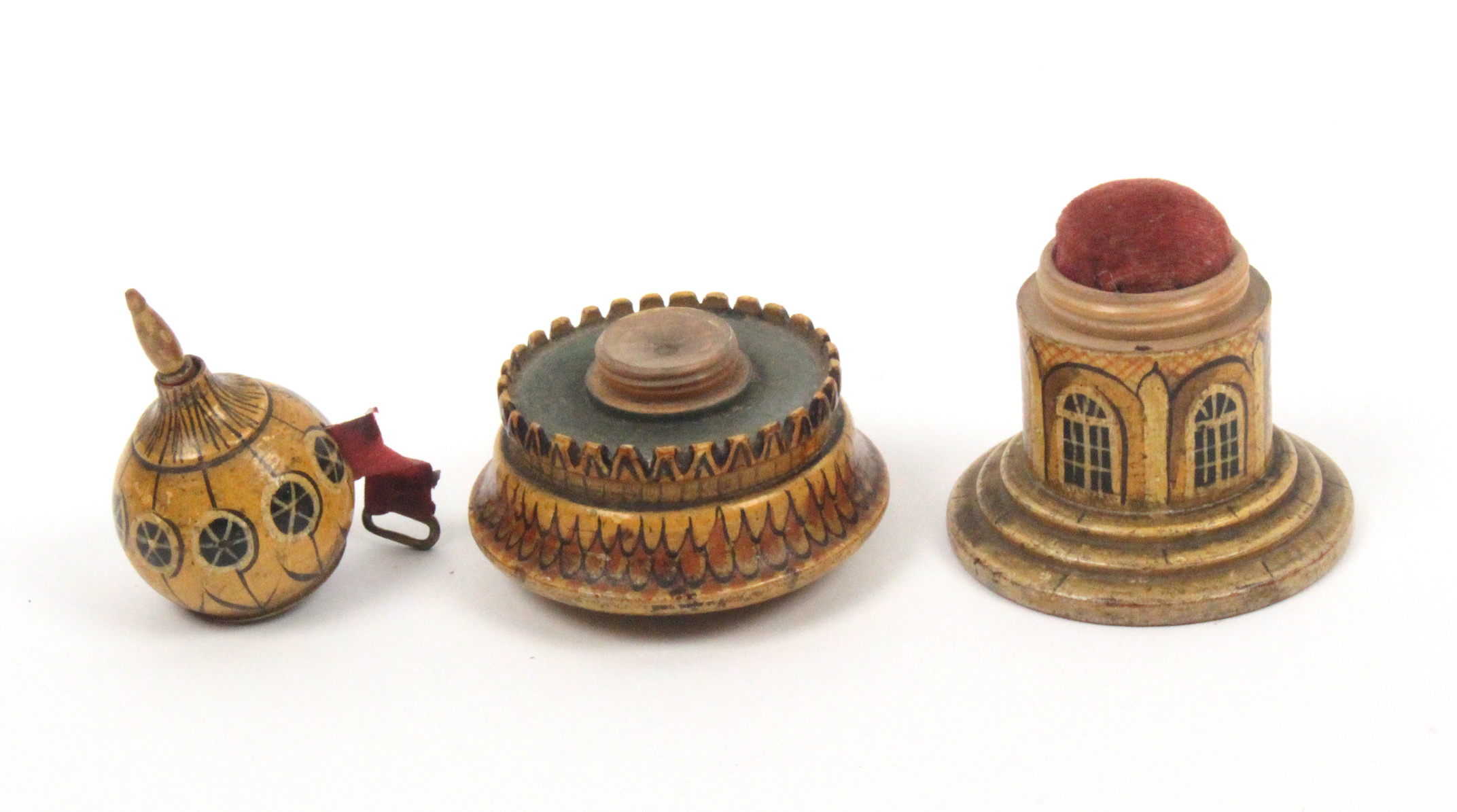 Lot 27 - An early painted Tunbridge ware combination pin cushion/tape measure in the form of a Brighton