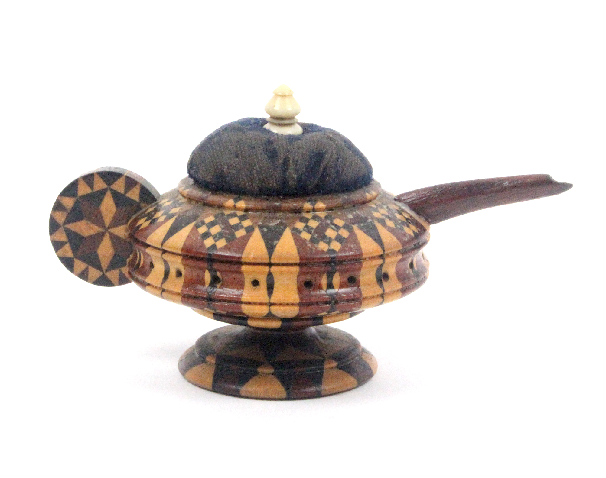 Lot 24 - A Tunbridge ware pin cushion in the form of a teapot, in turned stick ware with roundel form handle,