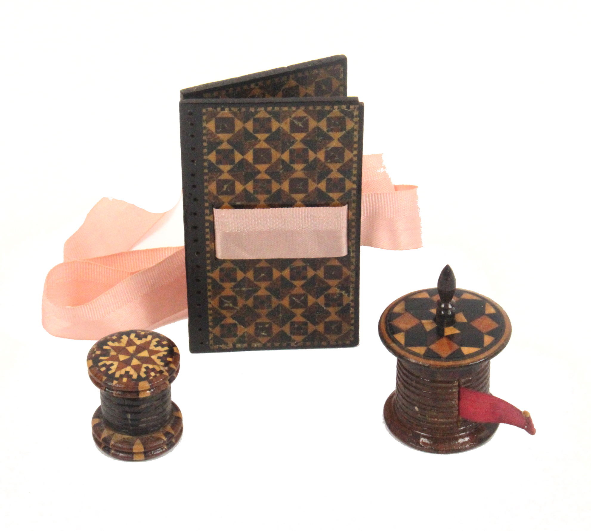 Lot 26 - Tunbridge ware - sewing - three pieces comprising a ribbed cylinder form tape measure with