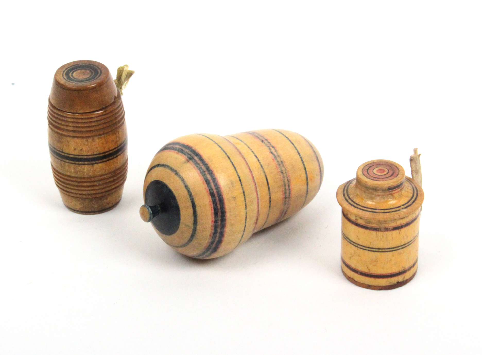 Lot 14 - Two early painted Tunbridge ware tape measures and a thimble case, comprising a barrel from