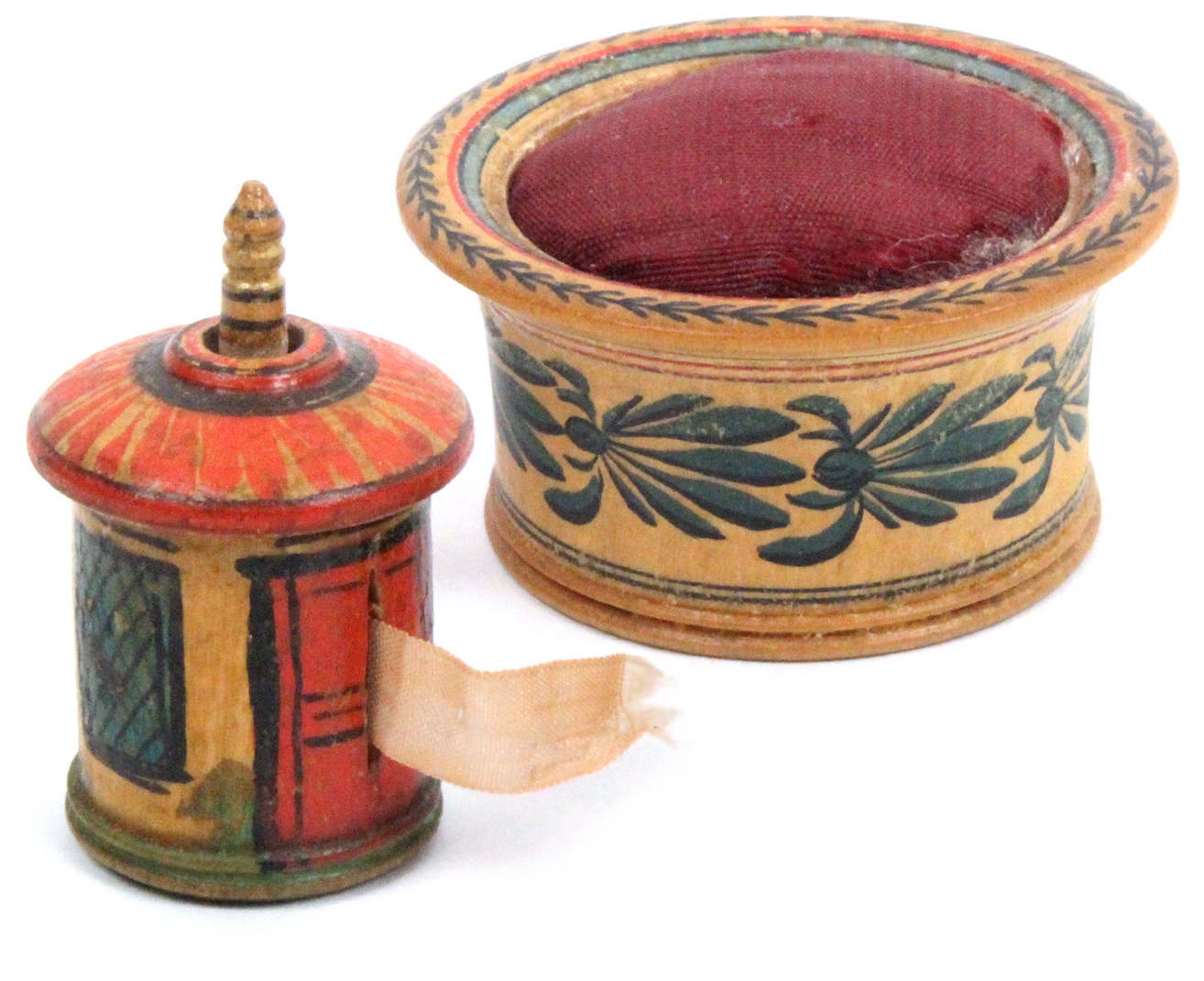 Lot 17 - An early painted Tunbridge ware pin cushion and a tape measure, the circular pin cushion with
