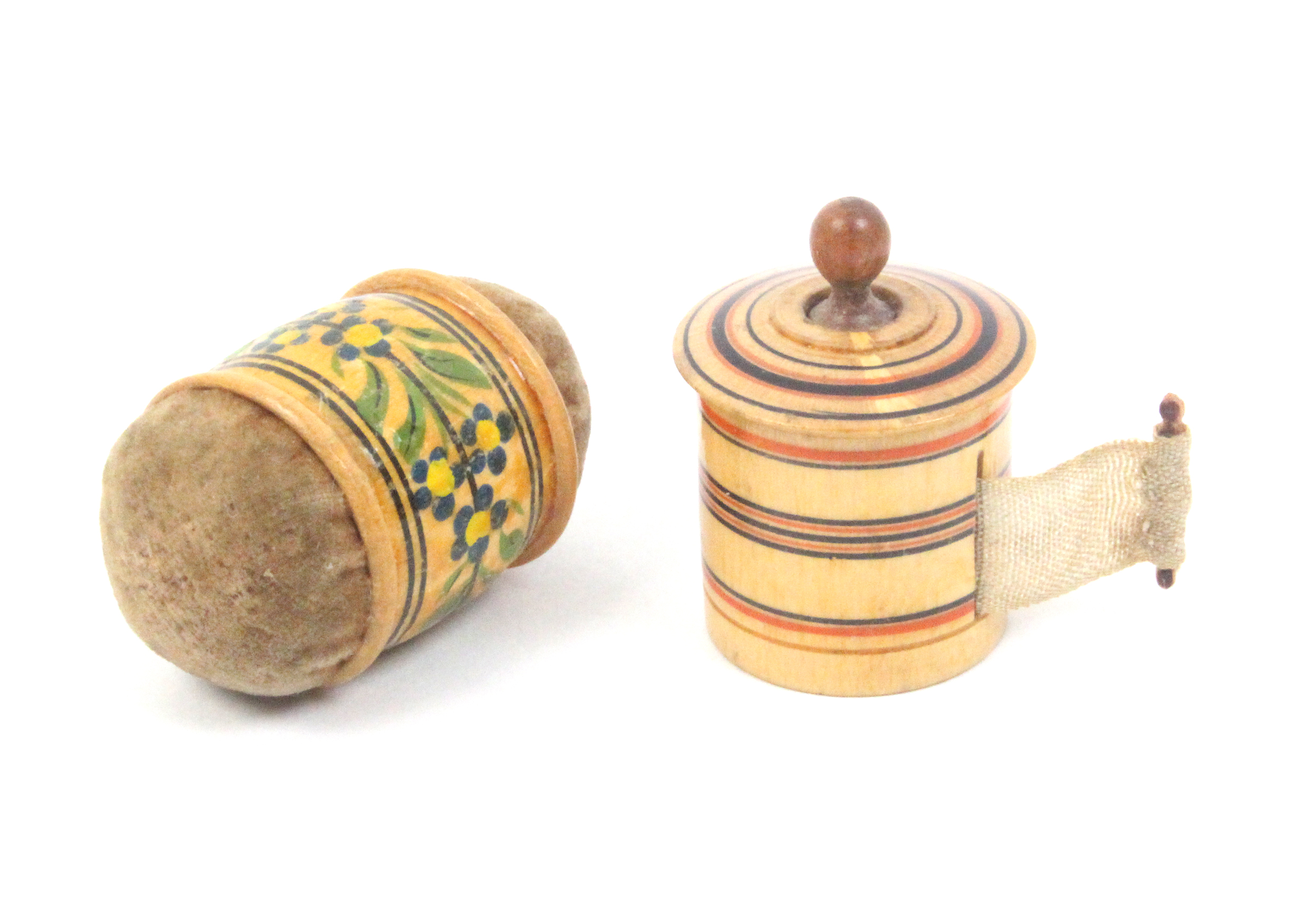 Lot 8 - A painted Tunbridge ware tape measure and a girdle pin cushion, the tape measure of cylinder form