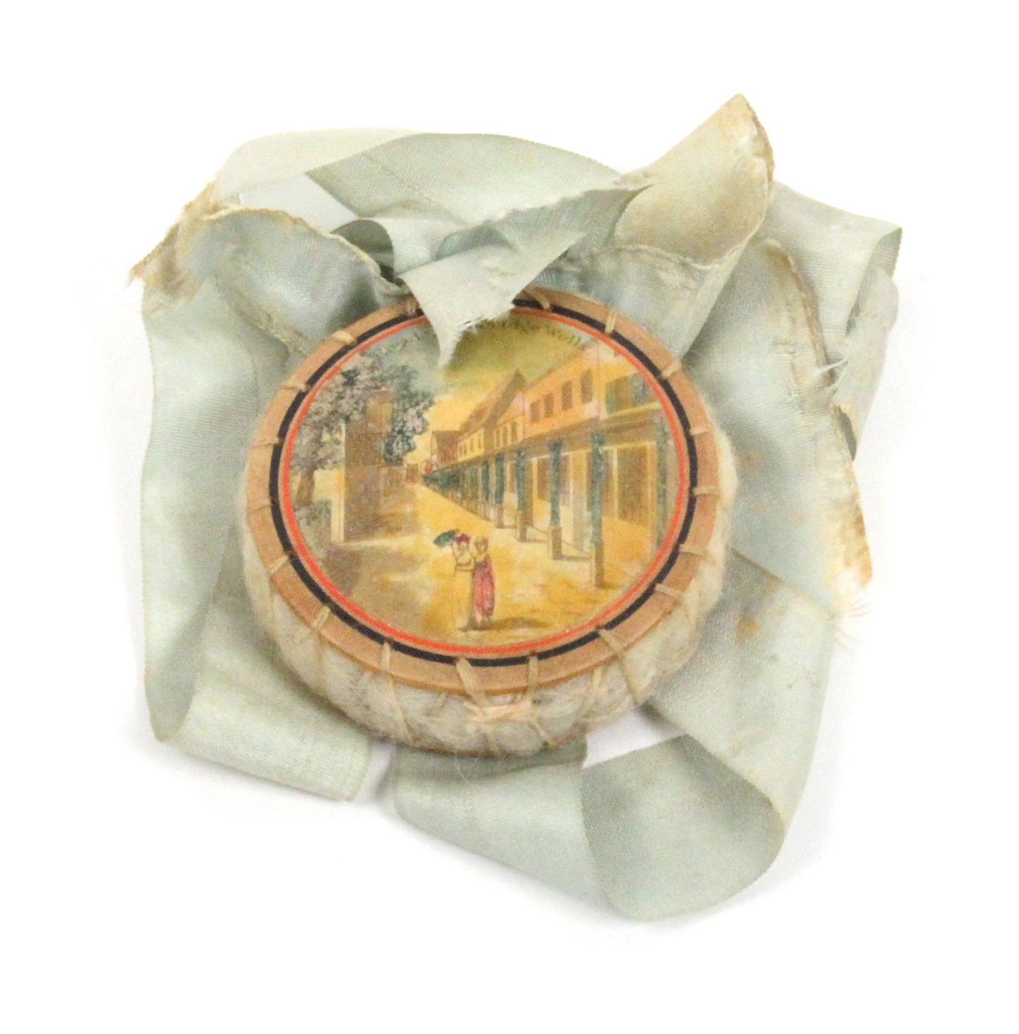 Lot 35 - A rare early Tunbridge ware circular pin cushion one side with a colour print titled 'Parade