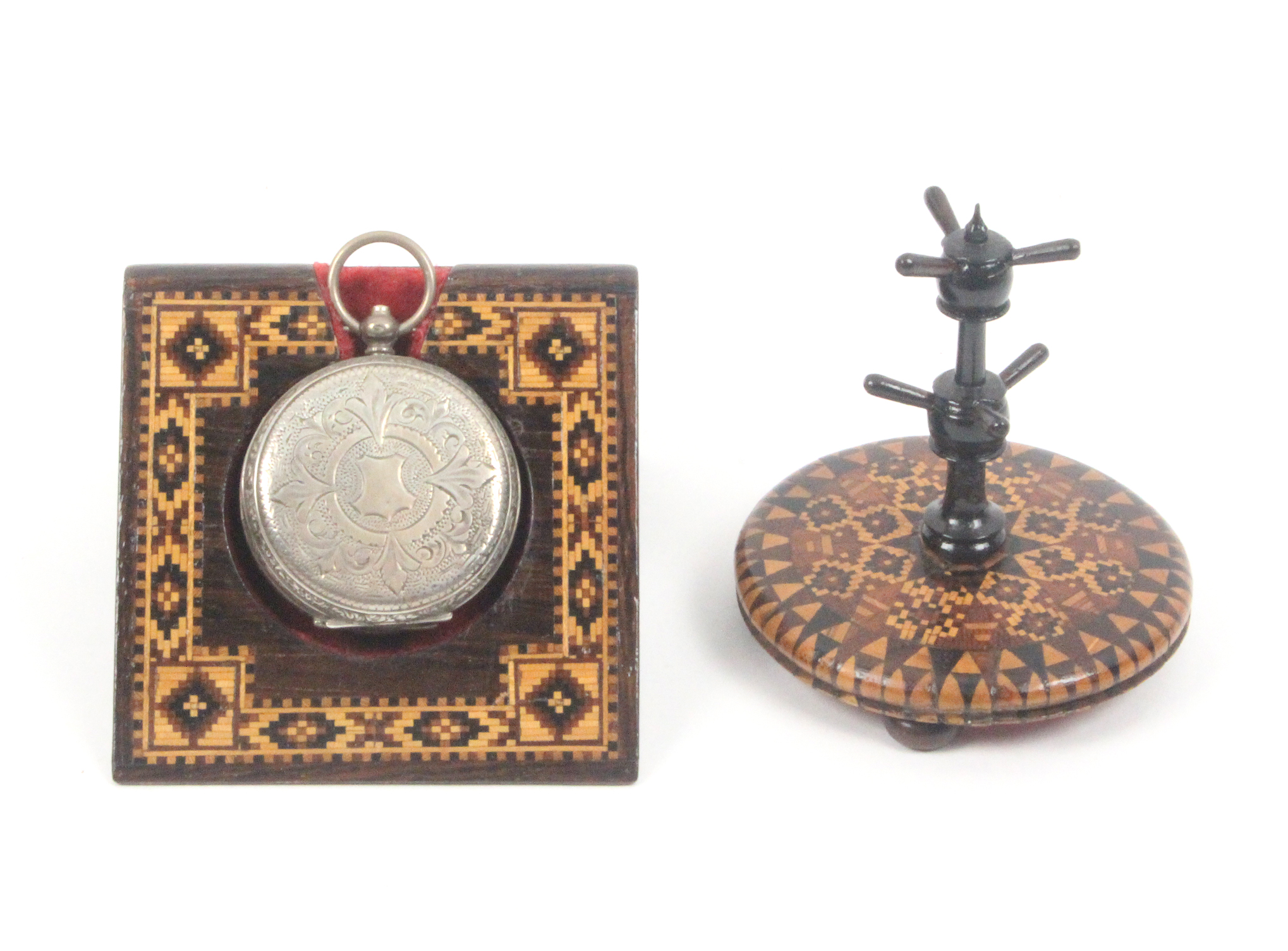 A Tunbridge ware watch stand and a ring stand, the first of angled form with a border of geometric