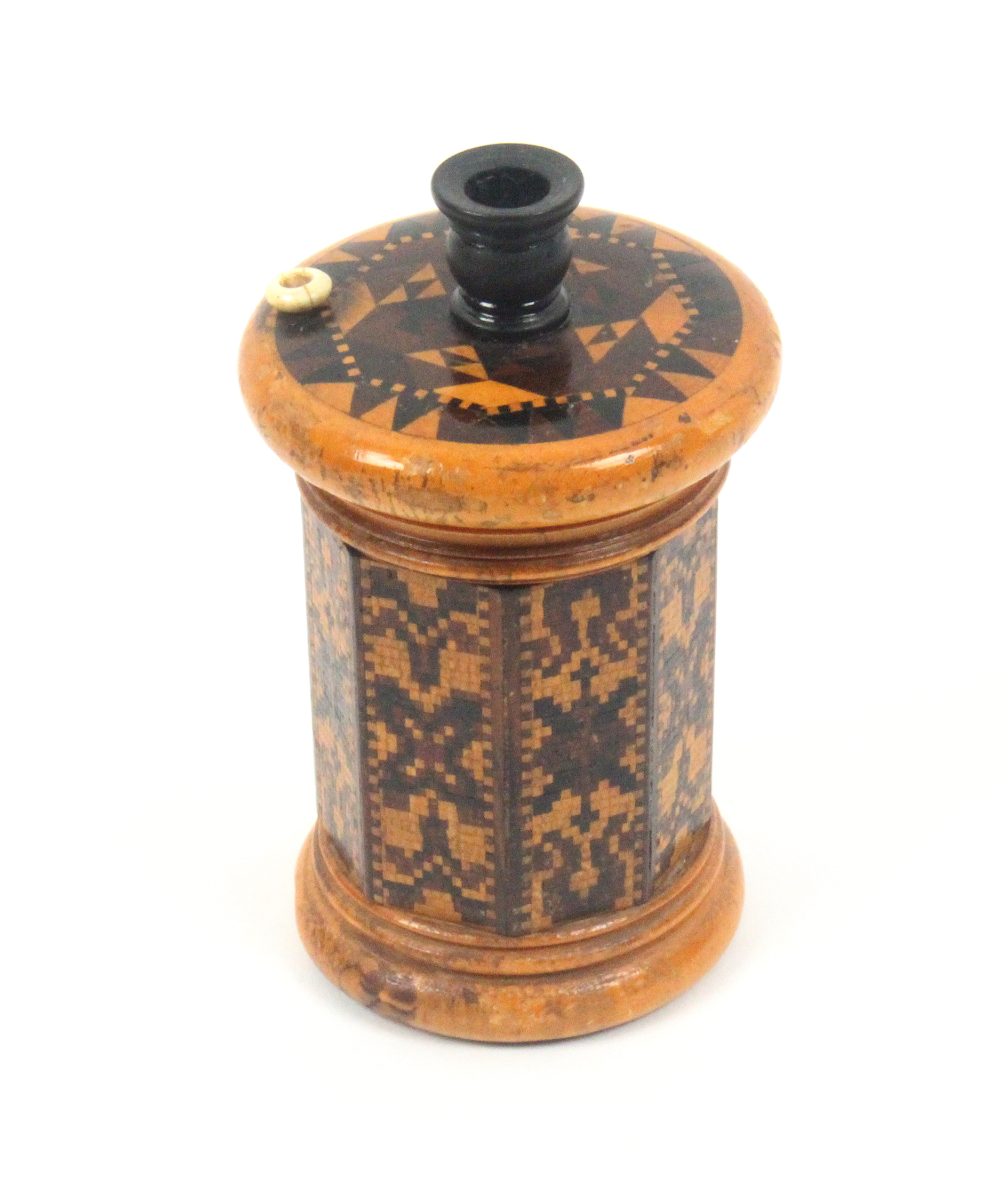Tunbridge ware - a large go-to-bed, the octagonal section body in bands of mosaic, the lid in