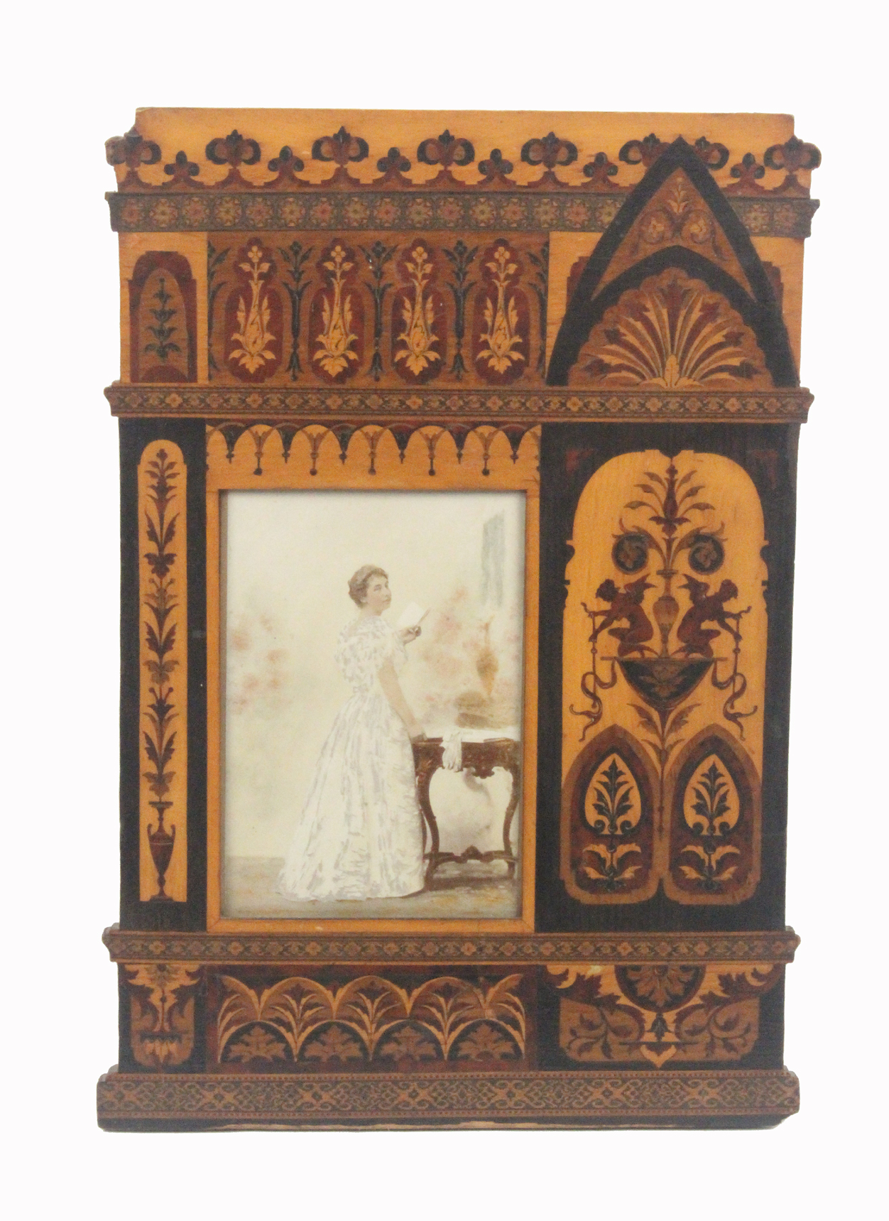 Lot 33 - An unusual Sorrento ware picture frame, the rectangular glazed aperture within inlaid panels of