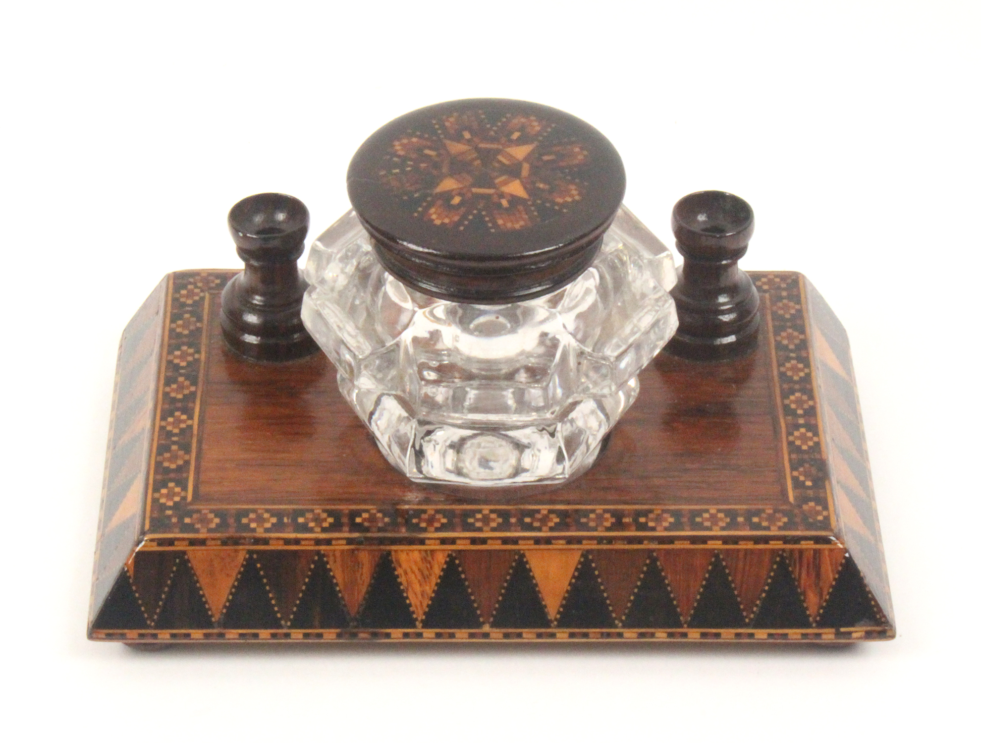 A Tunbridge ware rosewood ink stand, the rectangular base on four bun feet with a canted border in