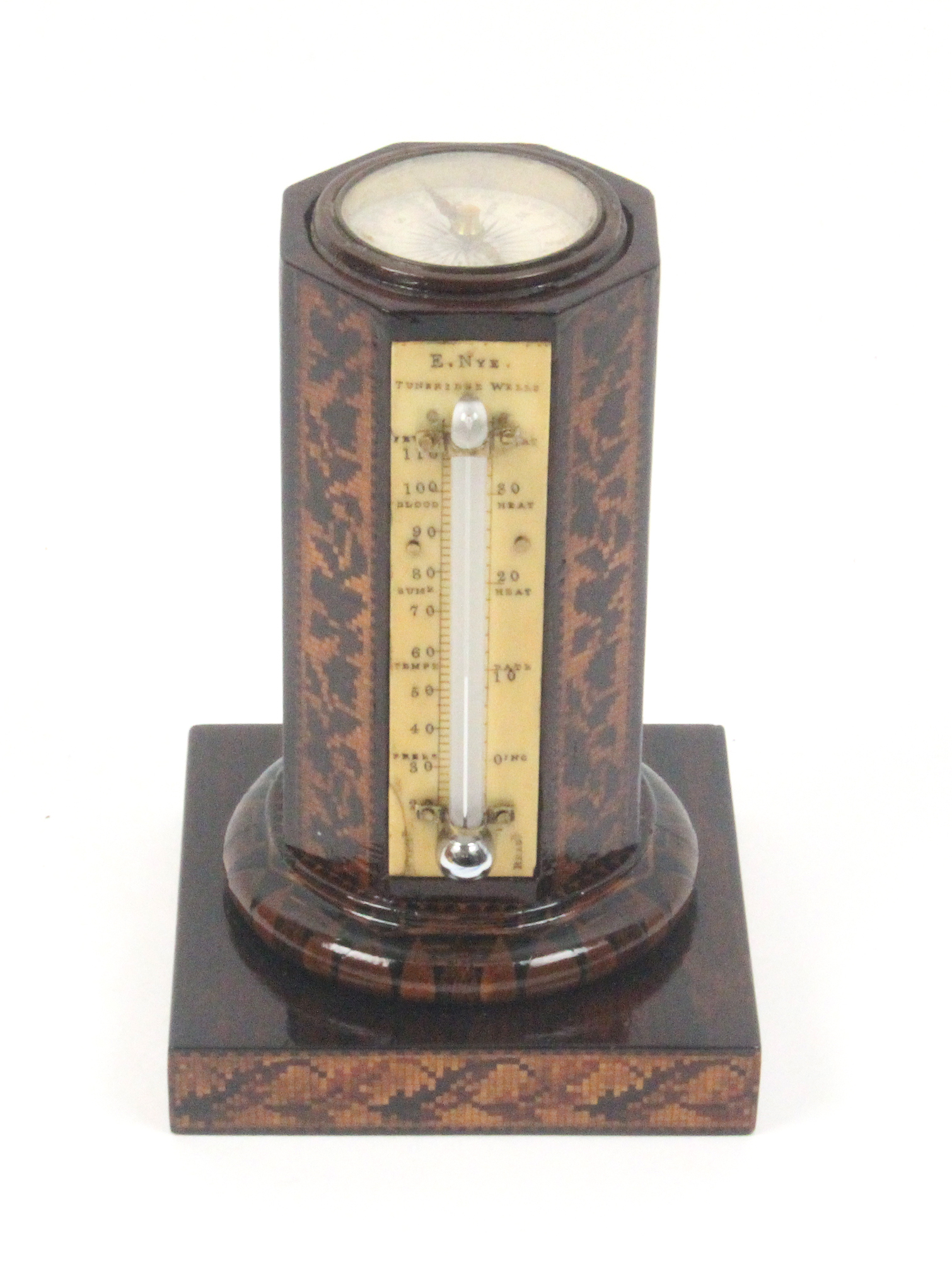Lot 40 - A rosewood thermometer and compass stand by Nye, the square base with floral mosaic sides, the
