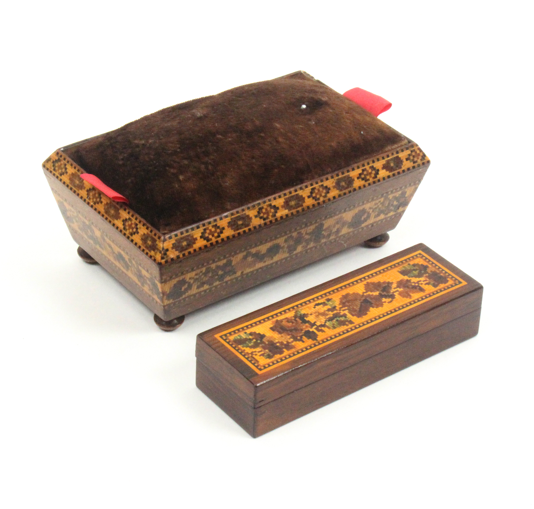 Tunbridge ware - two pieces comprising a sarcophagal form table pin cushion with two bands of mosaic