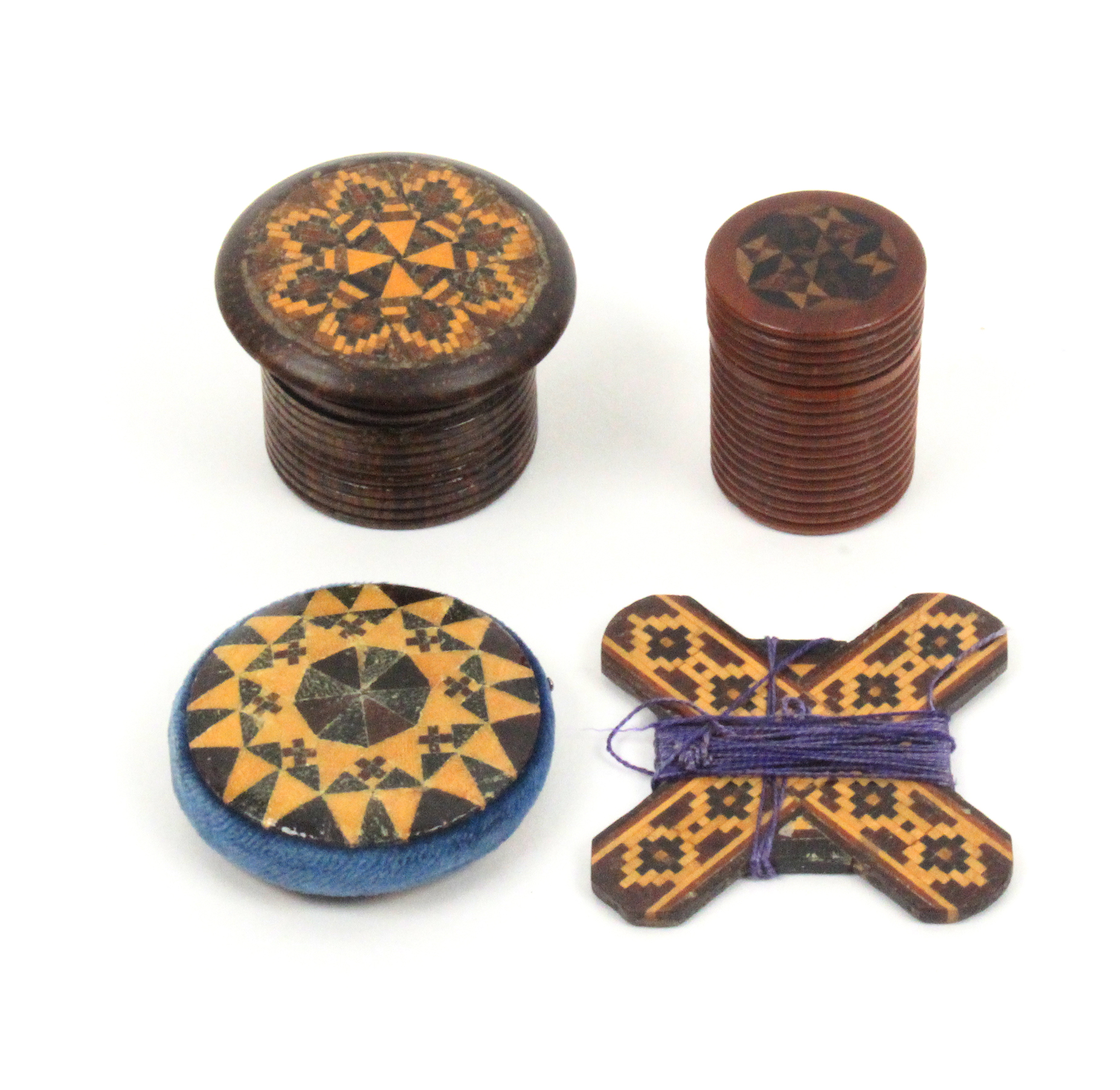Lot 2 - Tunbridge ware - four pieces comprising a disc form stick ware pin cushion, 4cm, a mosaic cross form