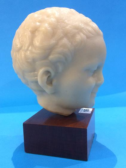 Lot 16 - A reproduction of a Roman bust study of a boy