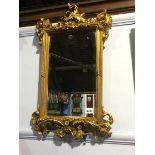 Lot 338 - An ornate gilt mirror, 61 x 37cm