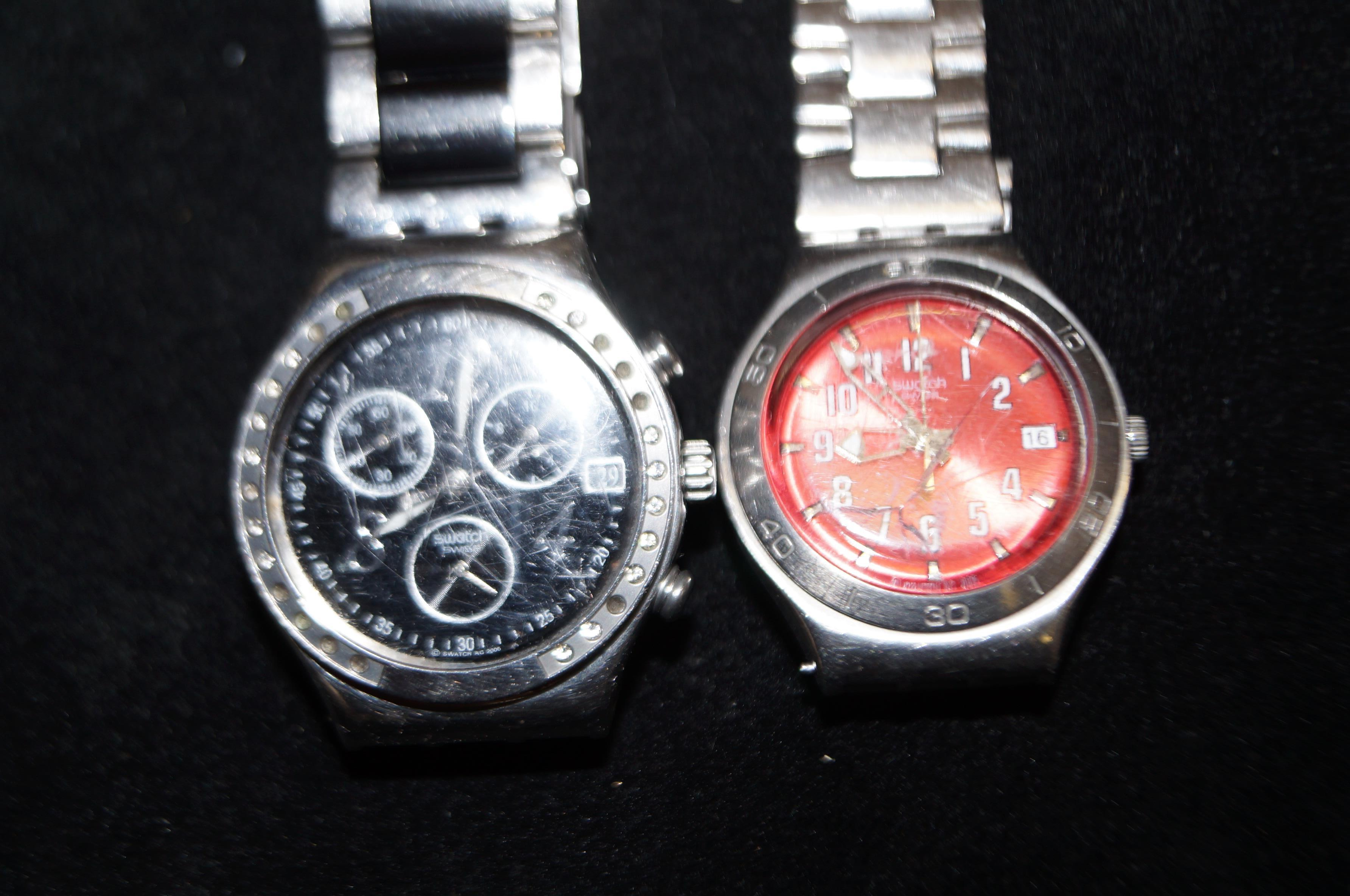 Lot 295 - 2x Swatch wristwatches