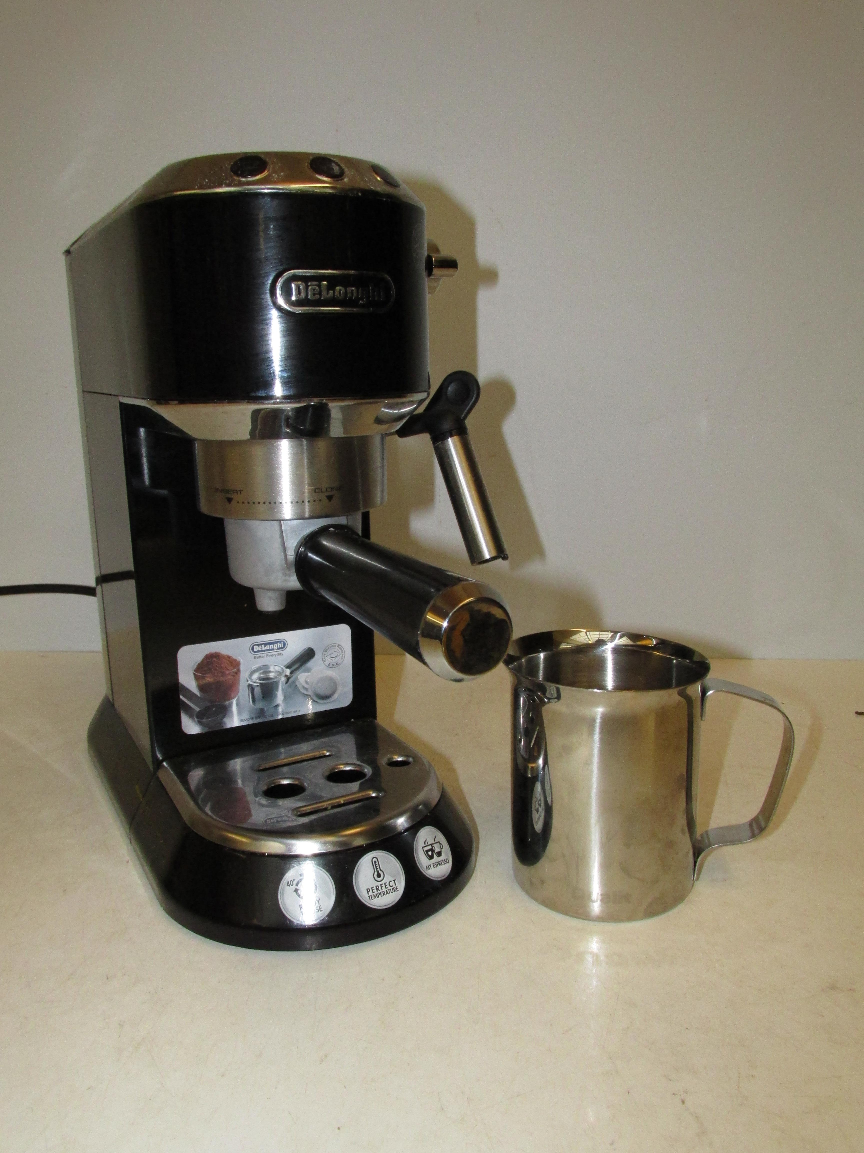 Lot 201 - De'Longhi EC685BK Traditional Pump Espresso Machine, working order together with a stainless steel m
