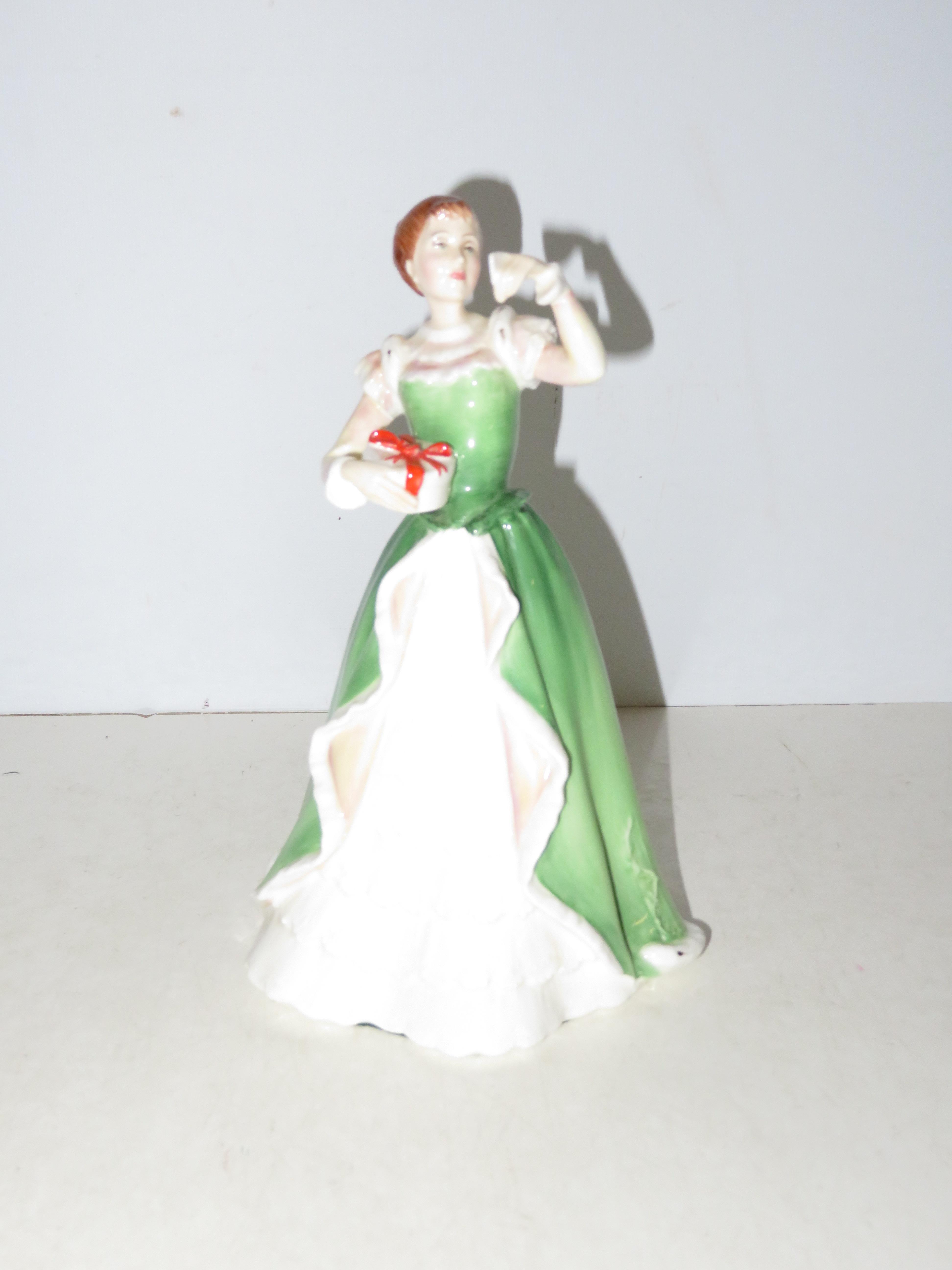 Lot 143 - Royal Doulton HN3096 Merry Christmas Height 23 cm