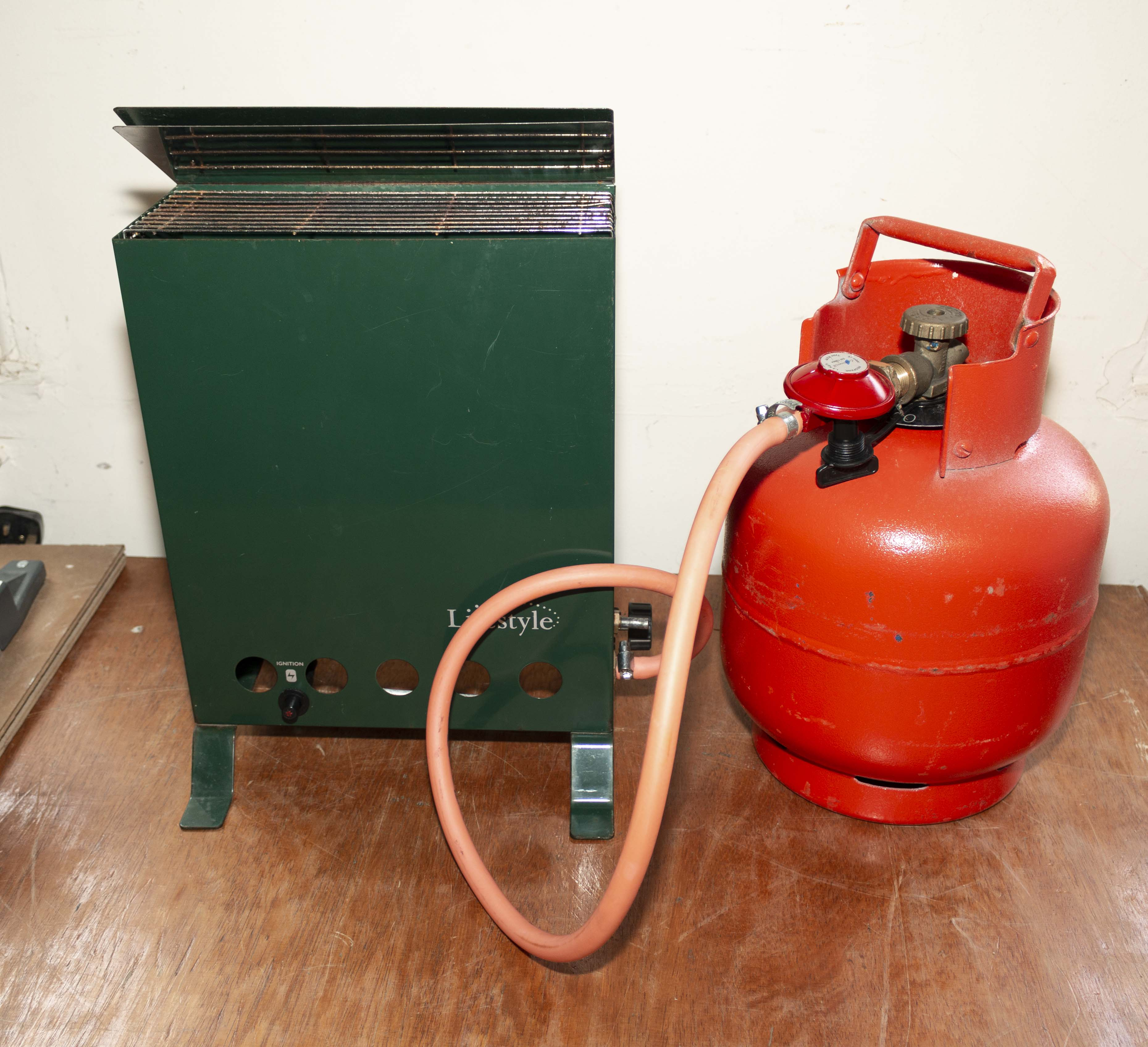 Lot 12 - A Lifestyle greenhouse heater together with a propane gas cylinder