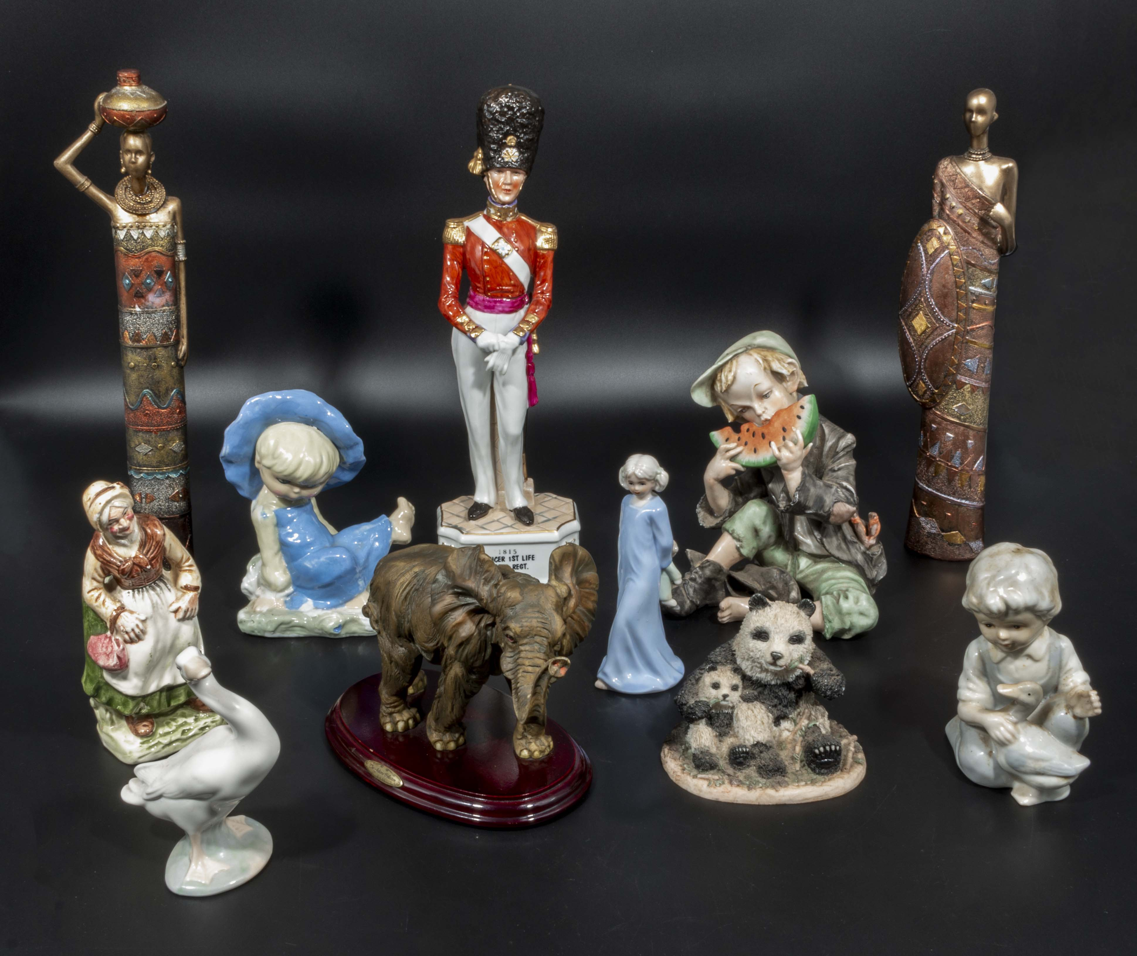 Lot 23 - Assorted pottery figures