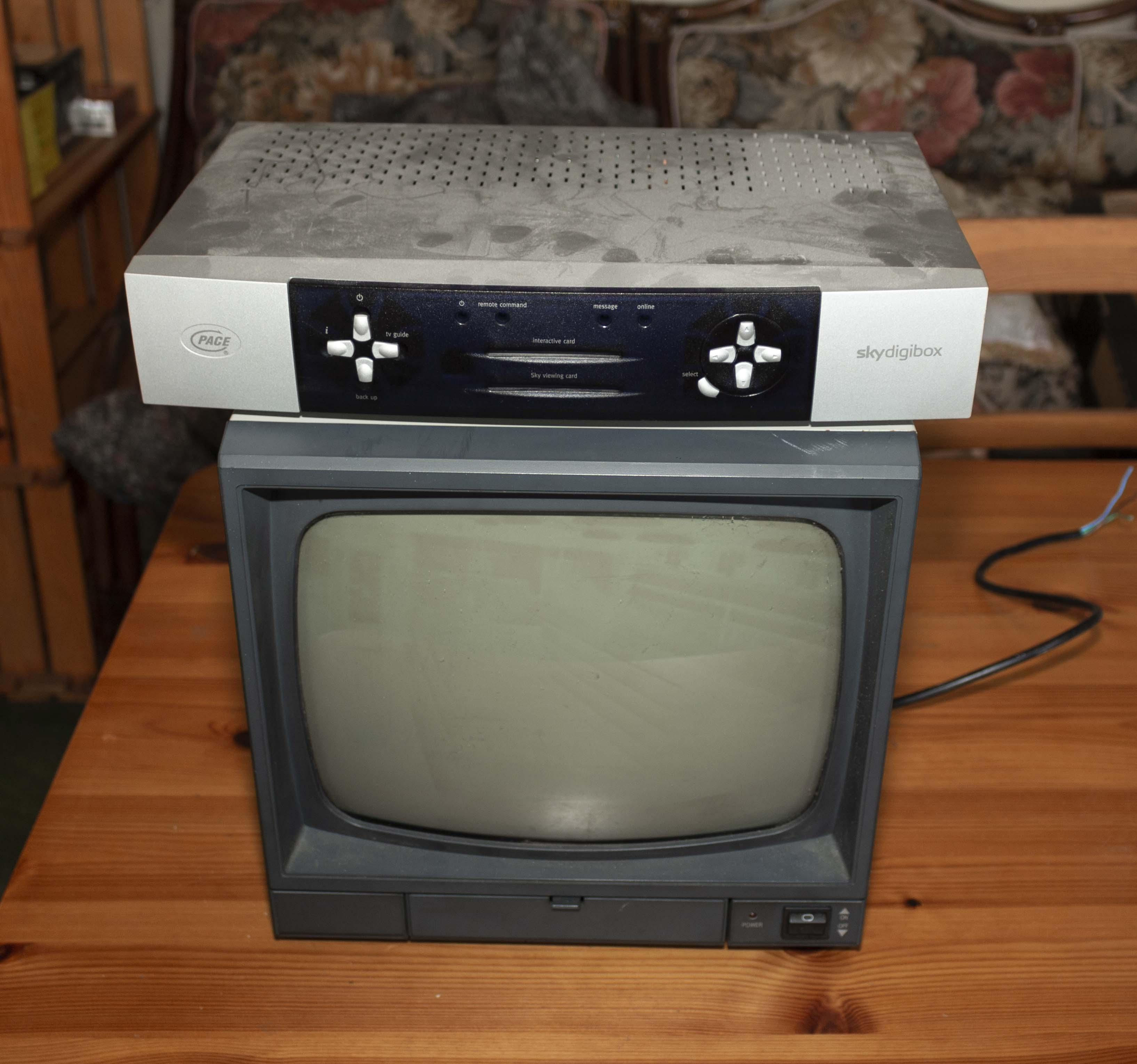 Lot 26 - A television and sky box