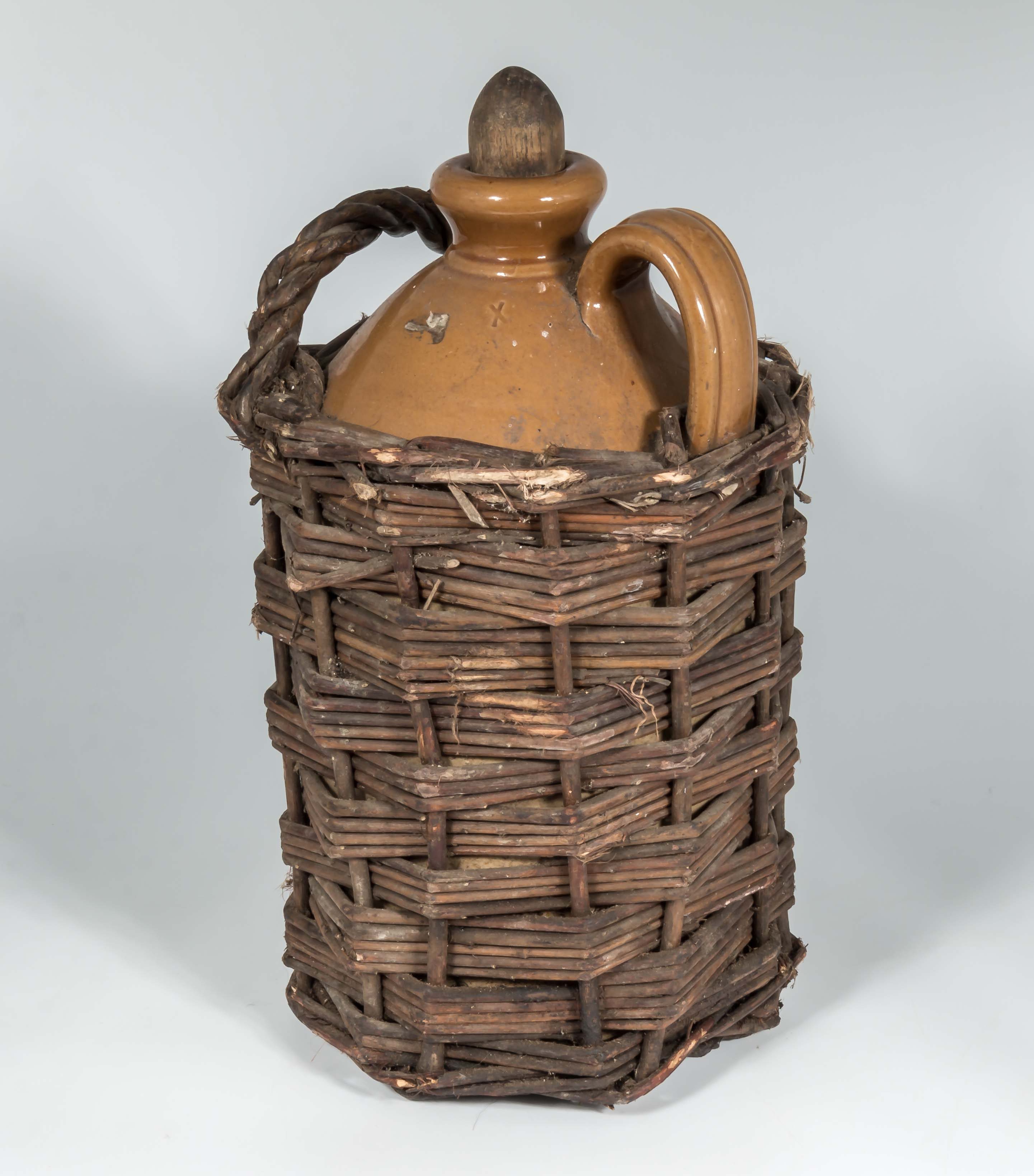 Lot 2 - A vintage earthenware wicker bottle