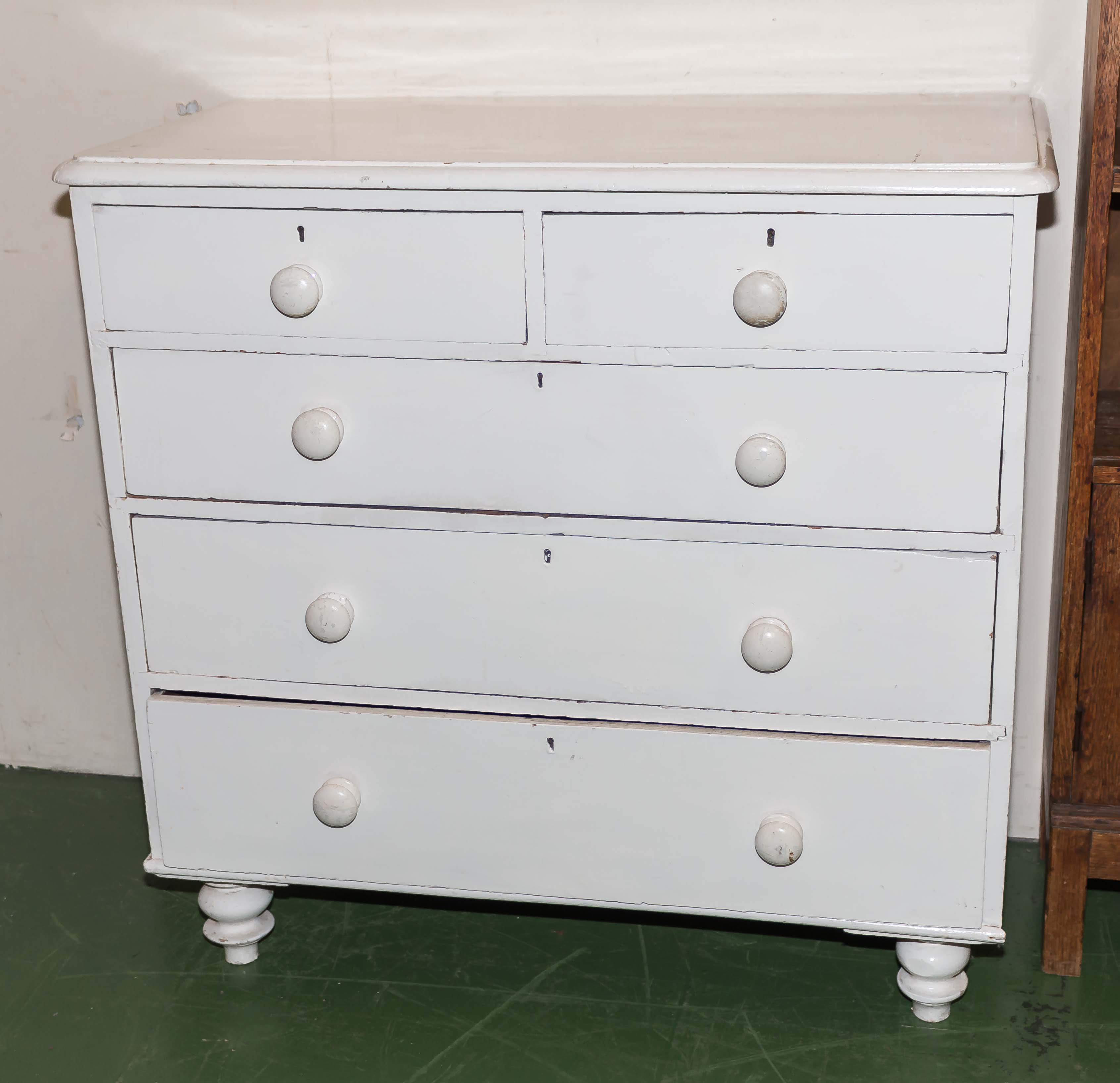 Lot 28 - A white painted pine chest of two drawers over three