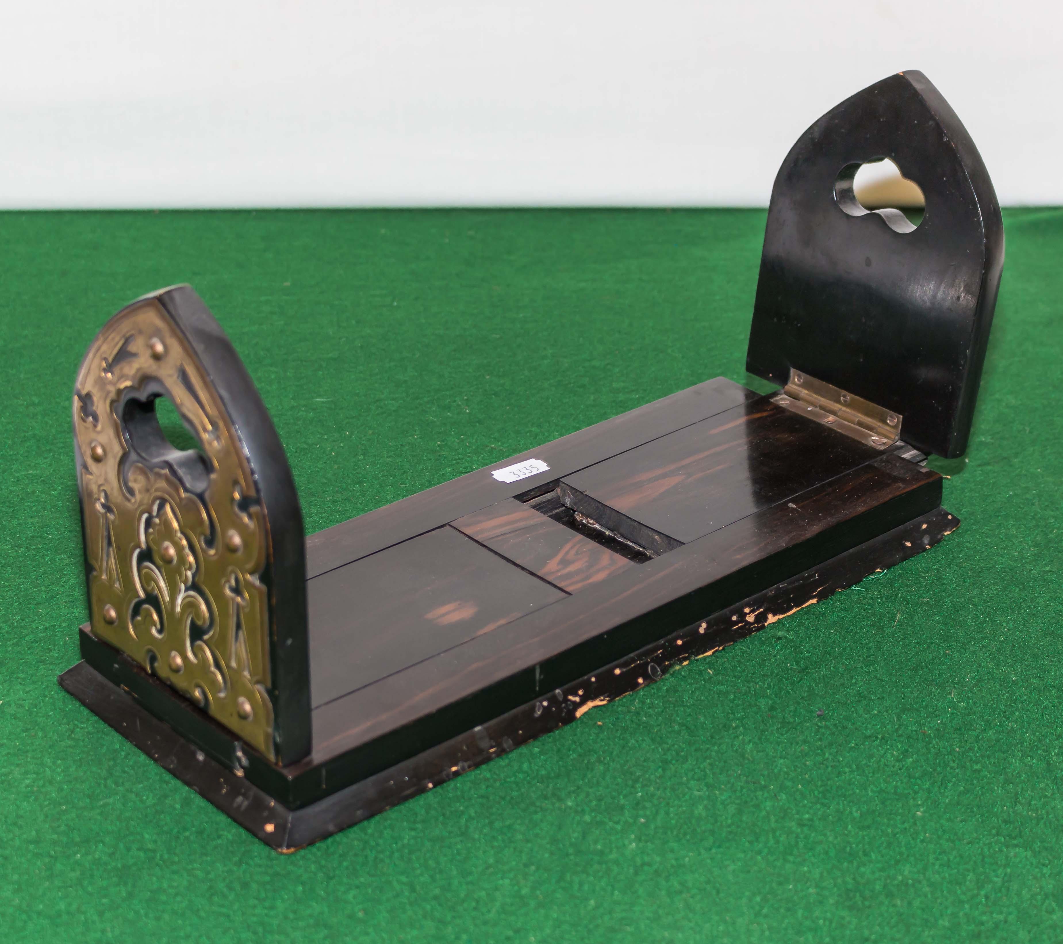 Lot 43 - A Victorian coromandel and brass book slide