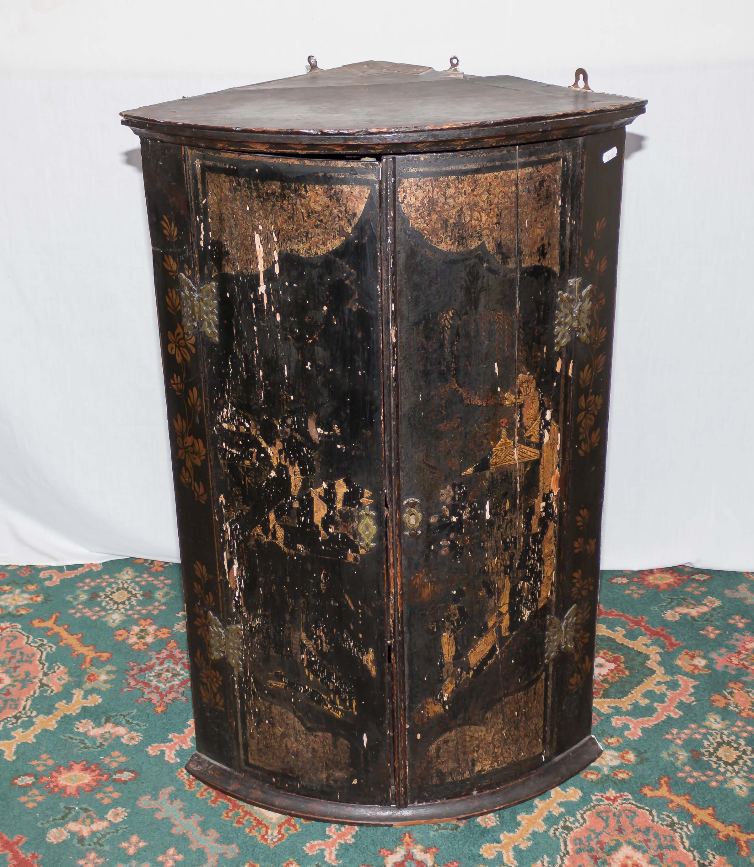 Lot 1 - A period oak lacquered corner cabinet, distressed