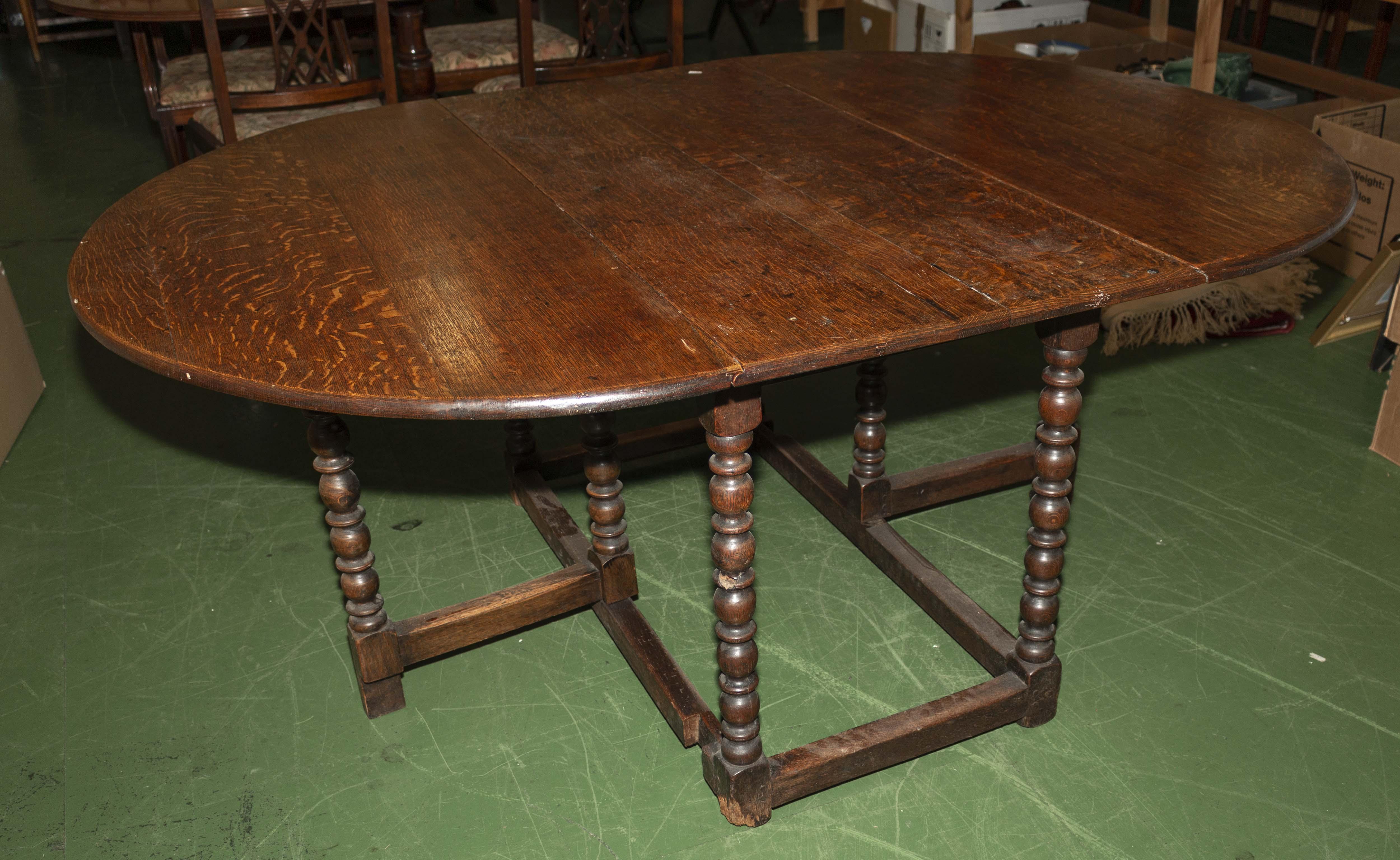 Lot 56 - A late Victorian oak gate legged table