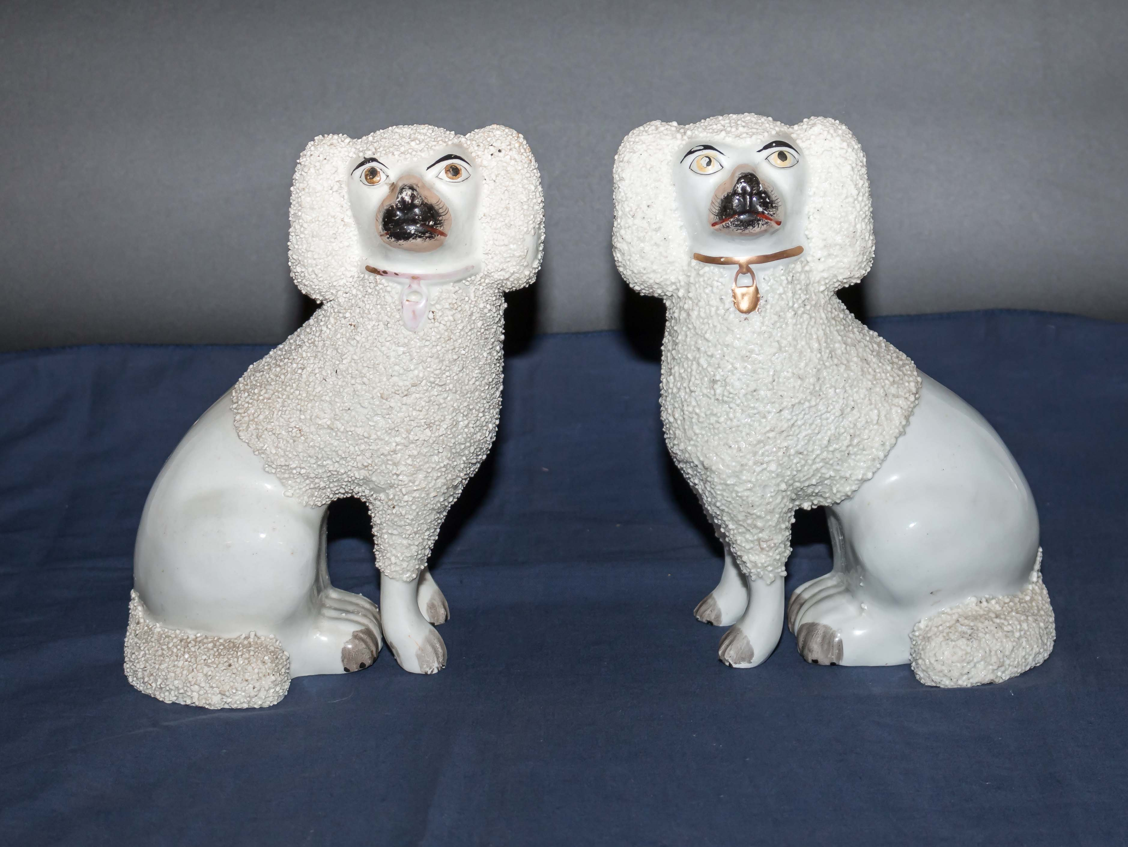 Lot 7 - A pair of Staffordshire dogs