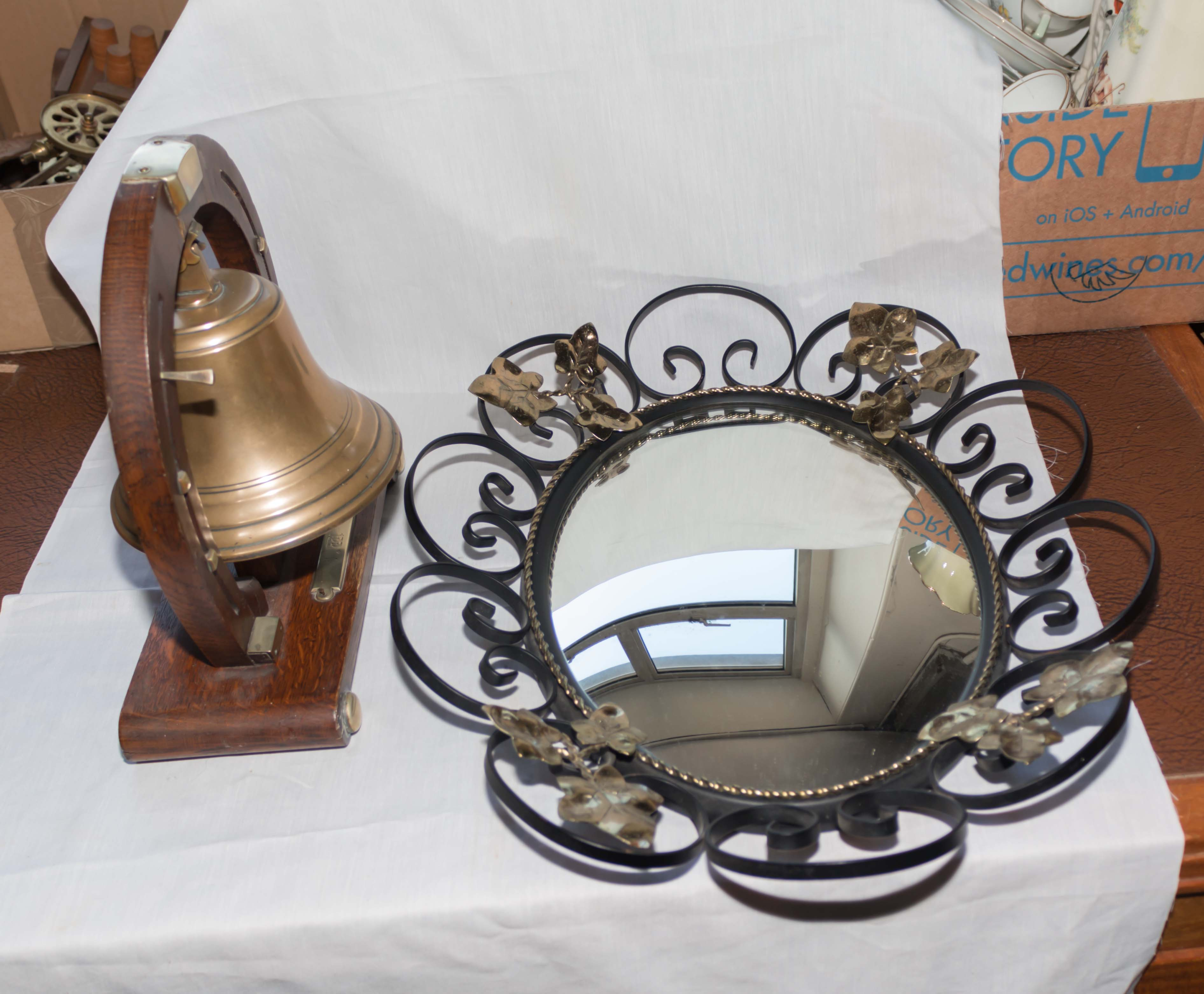 Lot 21 - A brass bell together with a mirror