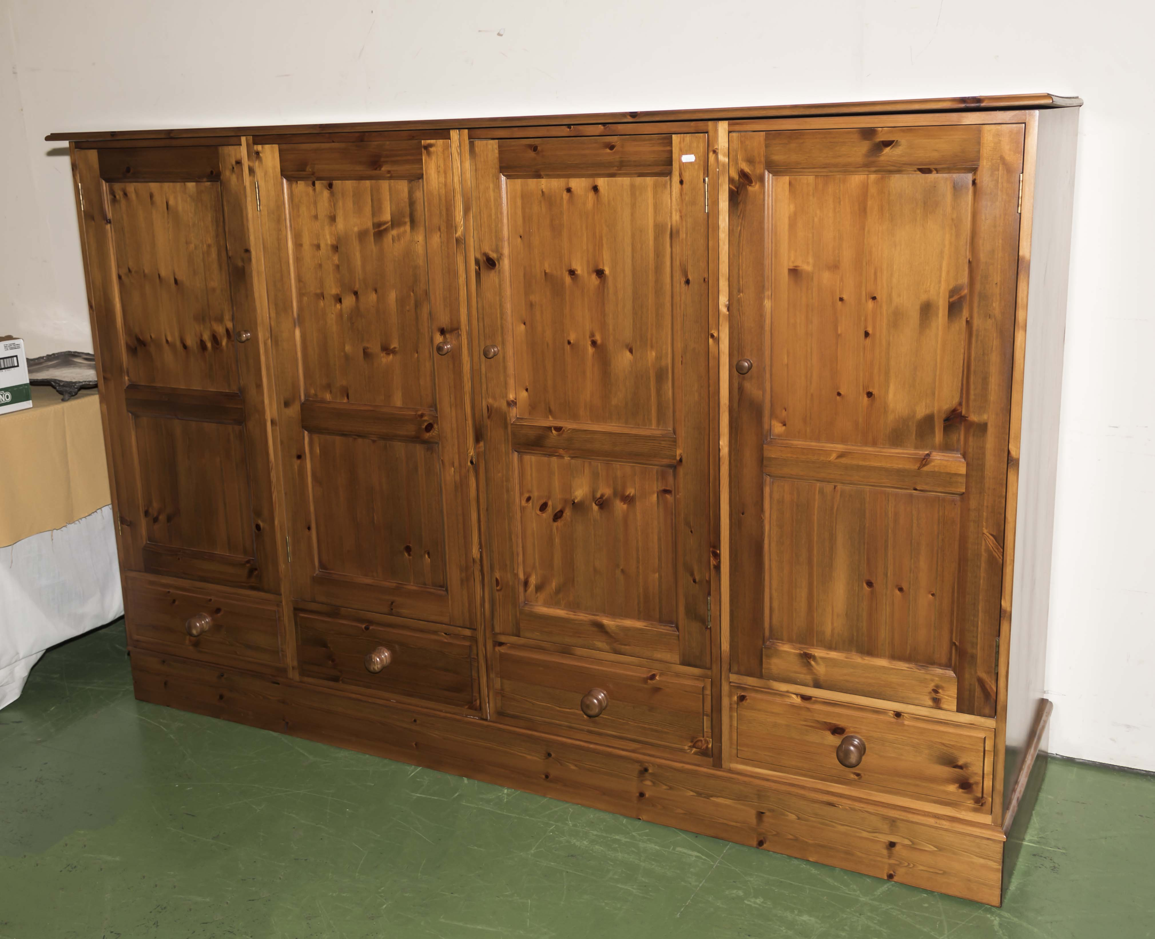 Lot 31 - A pine low wardrobe with drawers