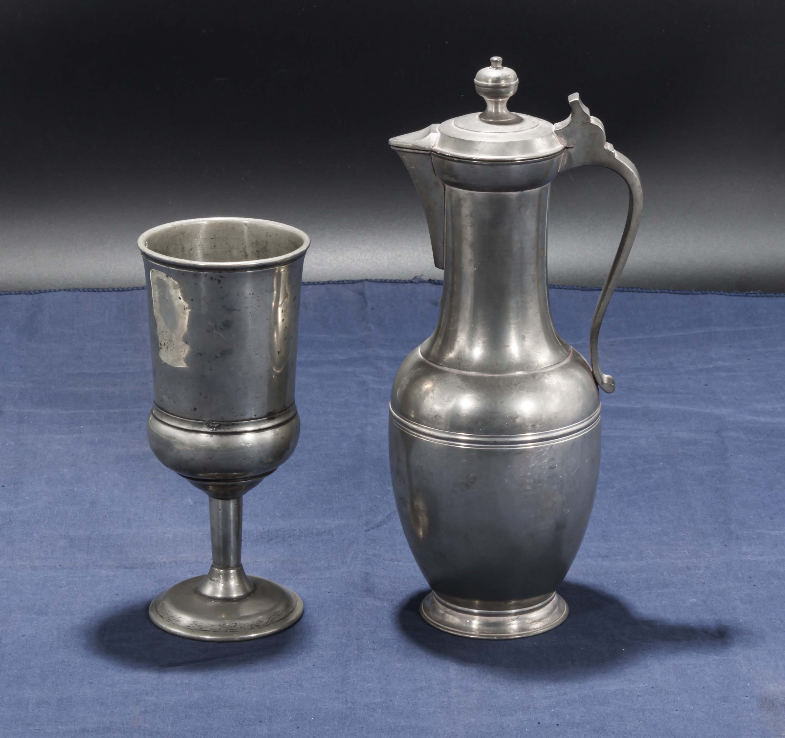 Lot 25 - Old Pewter wine flagon and goblet
