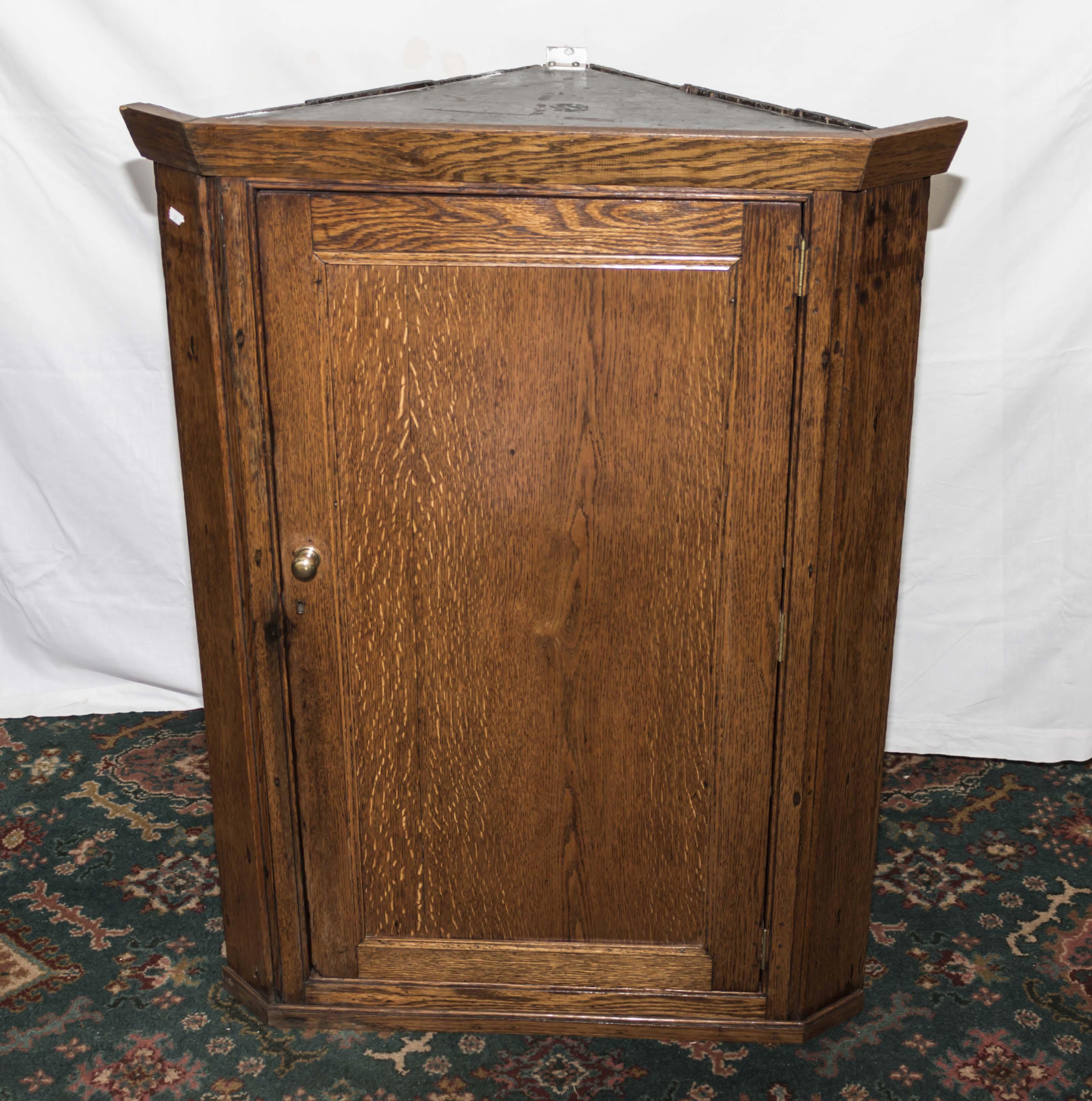 Lot 1 - An oak corner cupboard