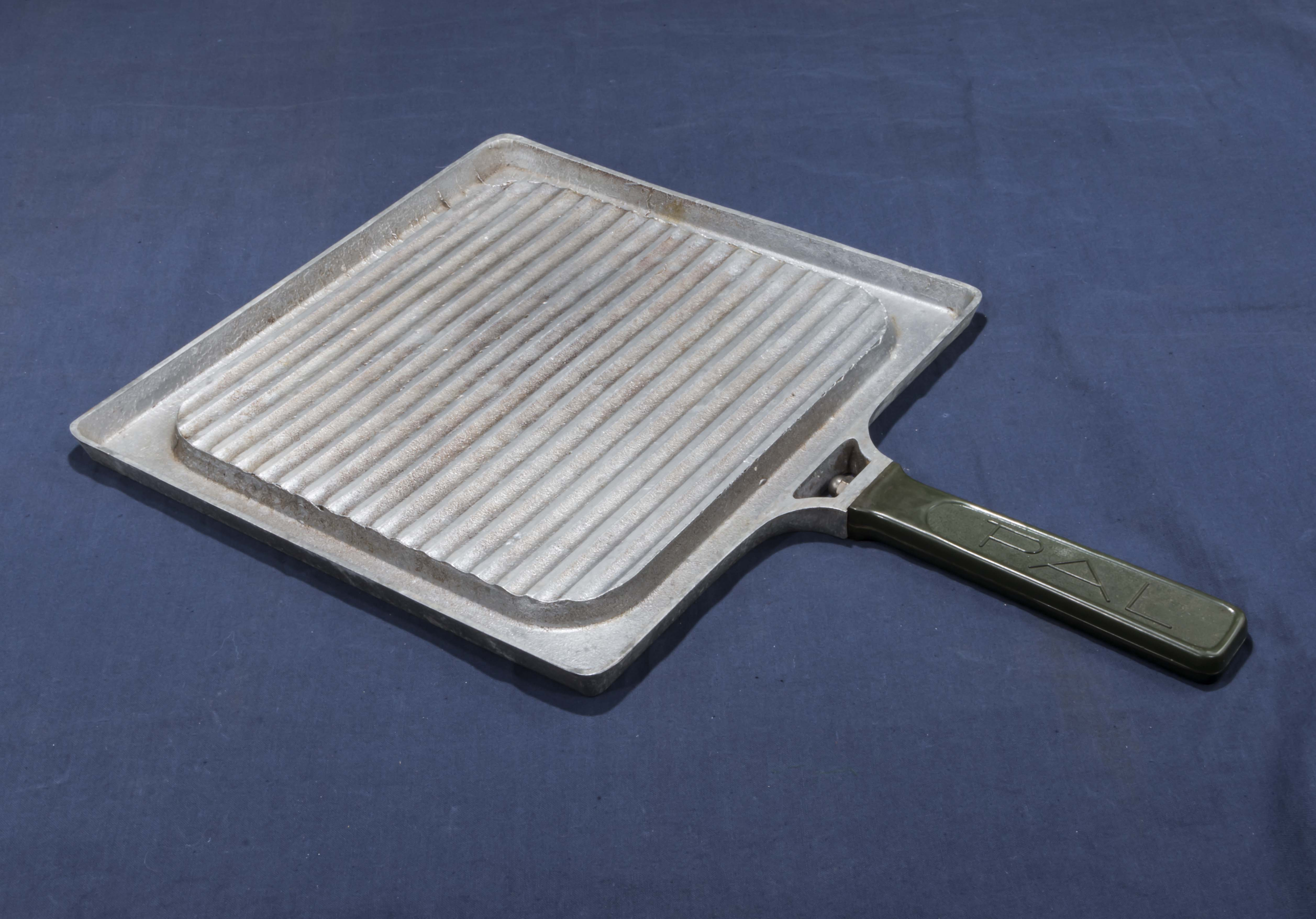 Lot 8 - Vintage griddle with folding handle and a 1940's combination griddle/grill
