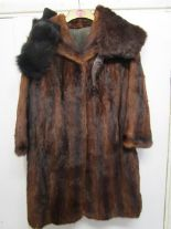Lot 3 - A vintage dyed musquash, knee length coat, together with a vintage rabbit wrap around hat and a pair