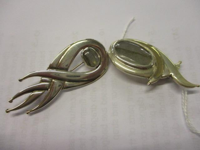 Lot 30 - Two silver and 9ct gold labradorite brooches, total weight 23.7g