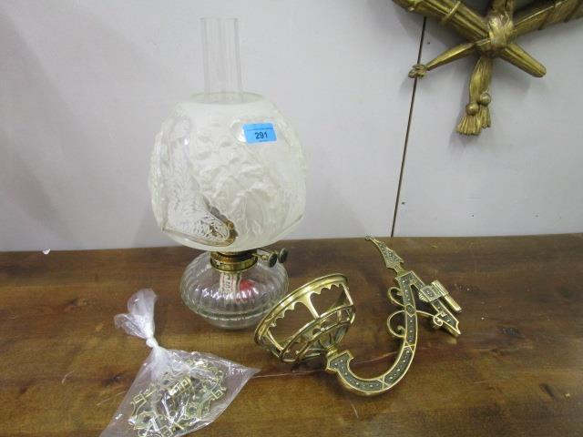 Lot 59 - A Duplex Victorian brass and glass oil lamp on a brass wall bracket holder with etched and frosted