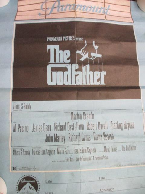 Lot 31 - An Al Pacino Scarface poster, framed and a quantity of The Godfather related posters and ephemera