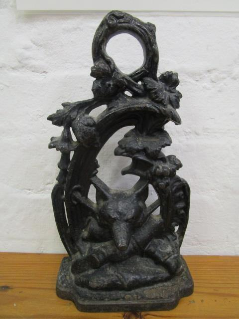 Lot 11 - A Victorian cast iron door stop decorated with a fox's head