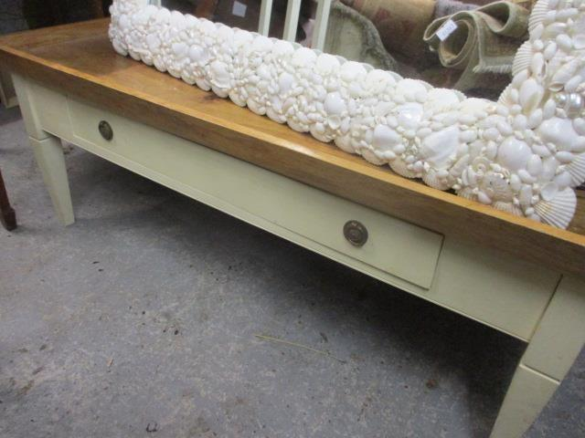 Lot 54 - A modern tray topped, square shaped coffee table, painted cream with internal drawers and an oak