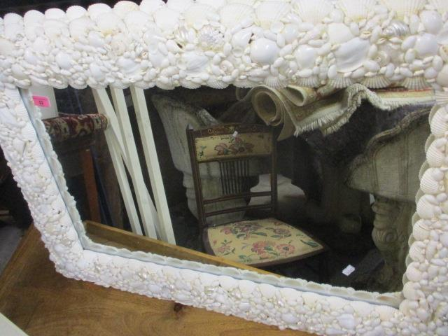 Lot 52 - A pair of modern rectangular wall mirrors with shell decorated frames