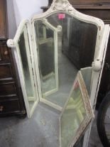 Lot 53 - A French style white painted shabby chic, three fold dressing table mirror and a smaller wall mirror